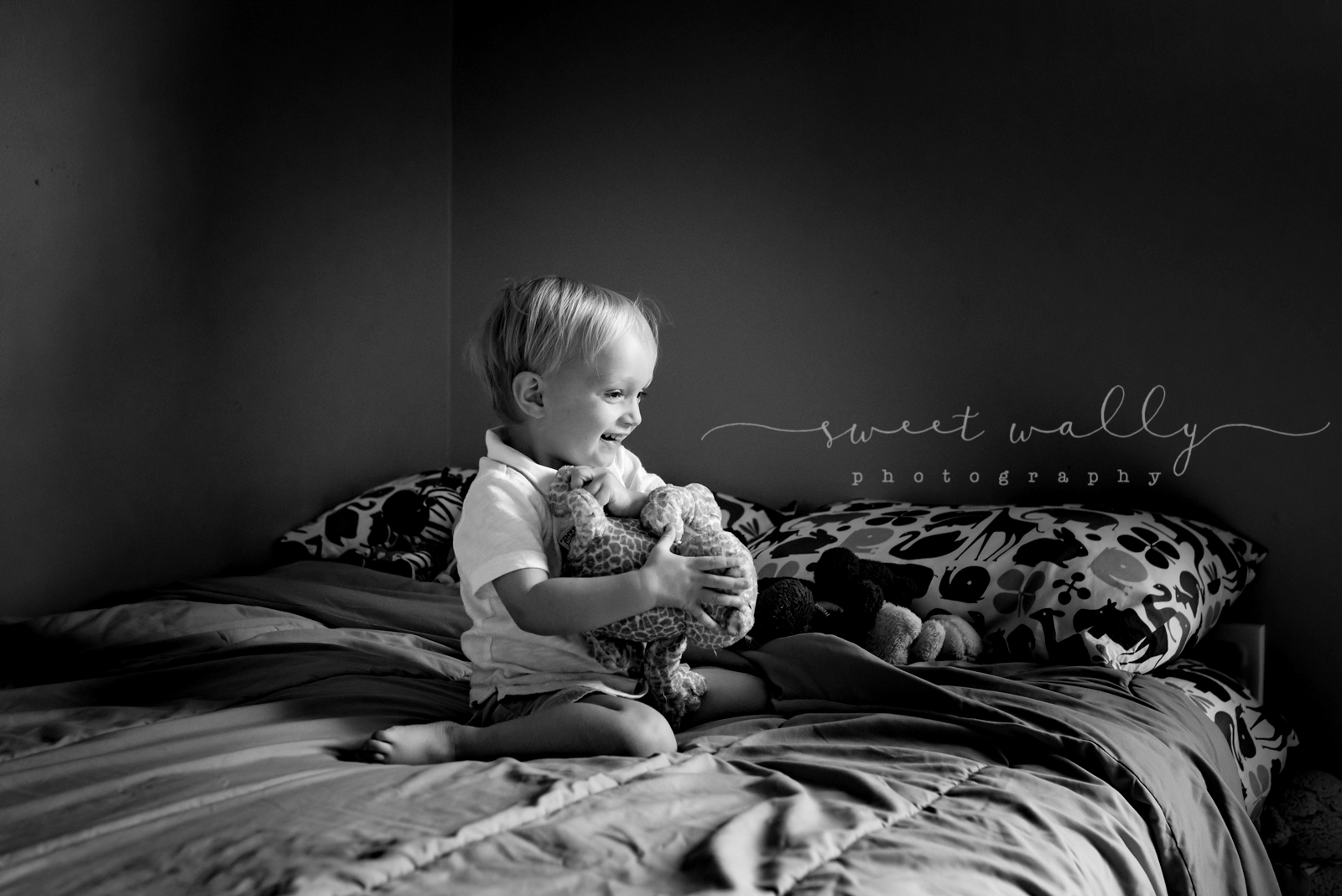 Big brother in his element | Lifestyle newborn family photo session by Sweet Wally Photography