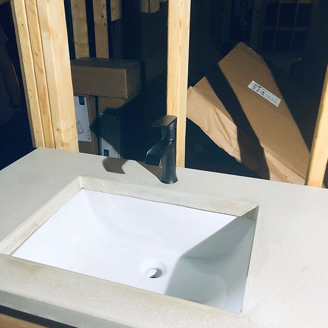 Jolly brothers wanted to make their own reclaimed wood vanity and concrete countertops to put in their soon to be bathroom.  Here's the result!