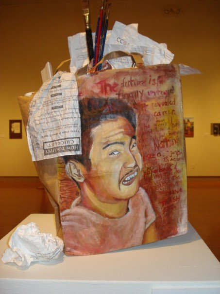 Destruction of my Dreams, mixed media: acrylics on paper bag stuffed with art school acceptance letters, paint brushes palette, 2005