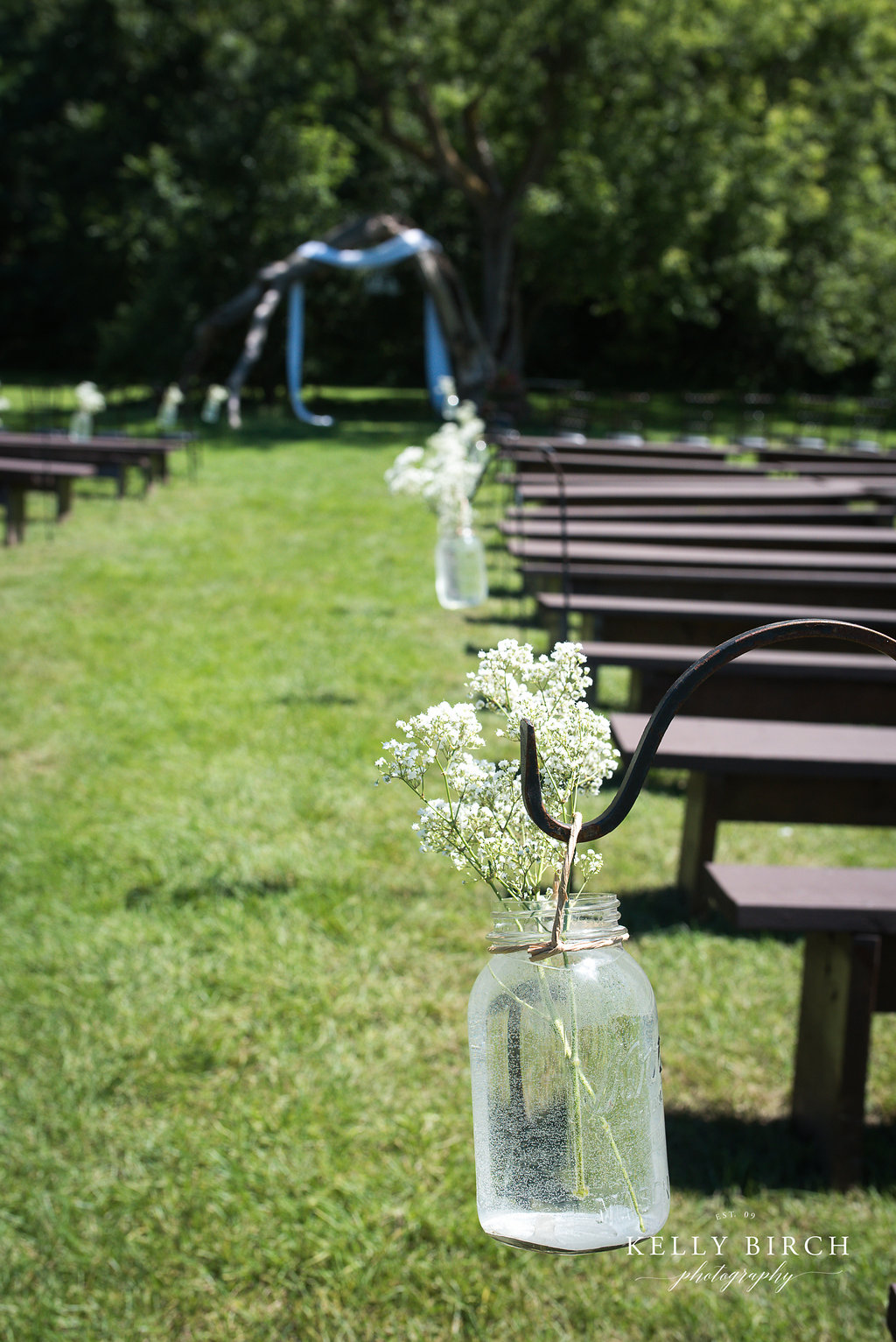 Wedding pews outdoor ceremony