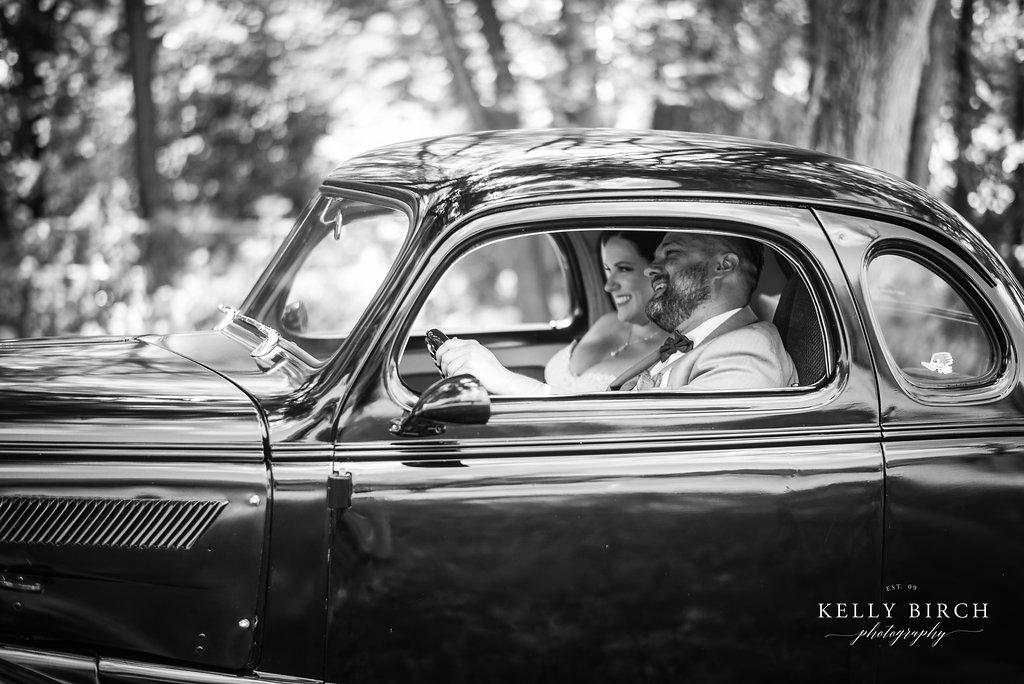 Vintage car for wedding photos - groom in a bowtie