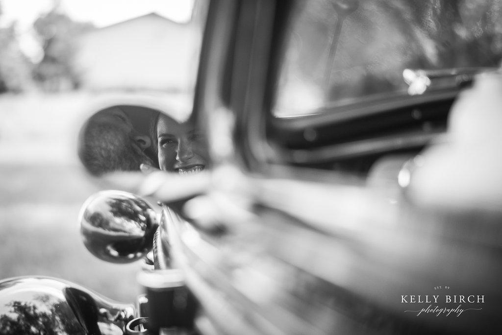 Wedding photos with a vintage car - rearview mirror
