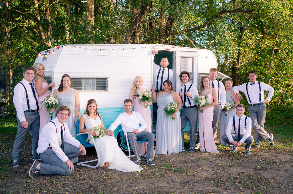 Bridal party photos with vintage trailer | pink and gray with bowties and suspenders | Kelly Birch Photography