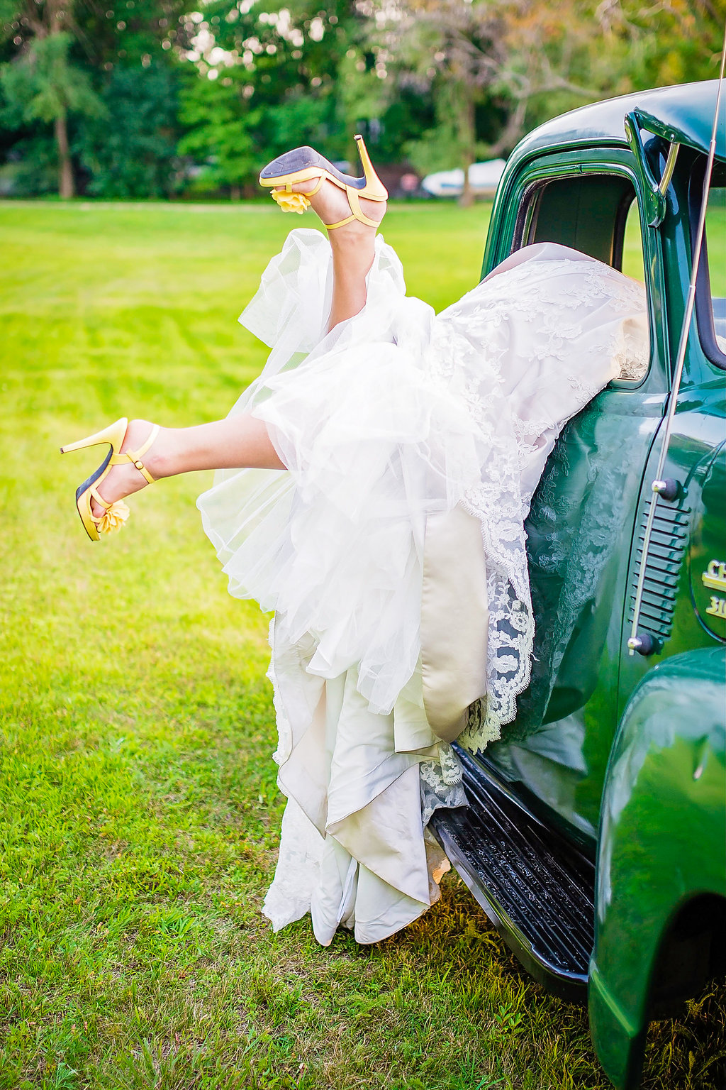 vintage truck, bride sticking out of the window | Kelly Birch Photography