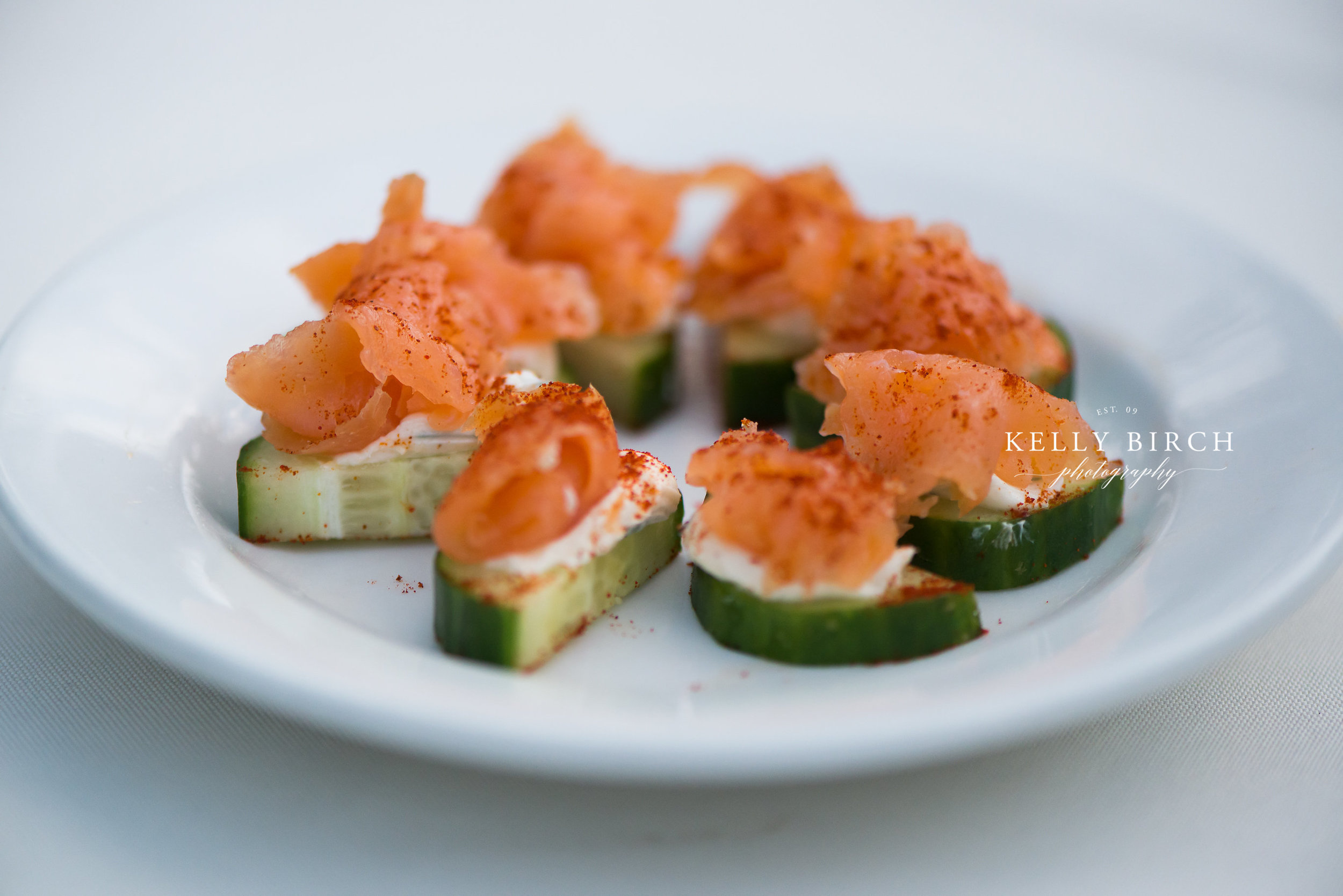 Mini cucumber salmon appetizer for wedding cocktail hour   photo by Kelly Birch Photography