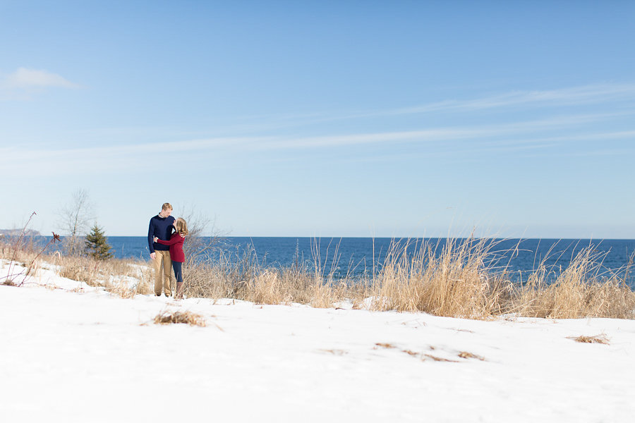 Winter engagement by the lake | navy khaki and red | Photo by Ashley Elwill Minneapolis wedding photographer