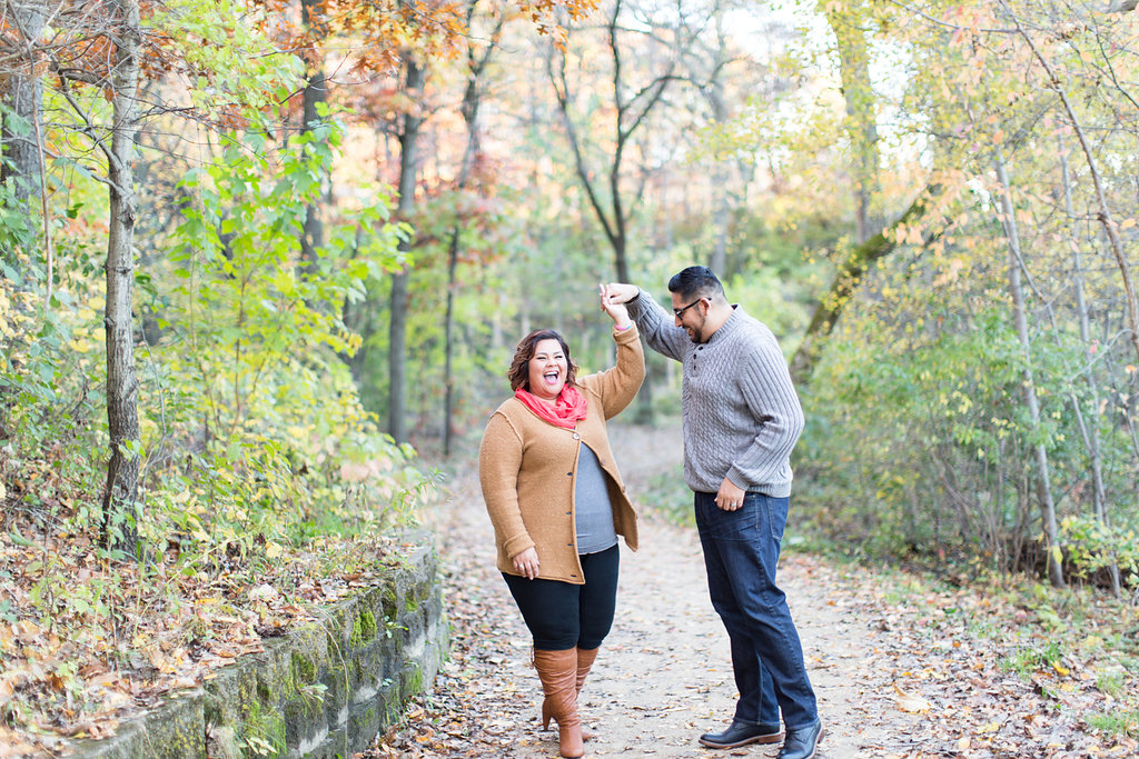 Jen from Amy's Cupcake Shoppe in Hopkins in a coral pink scarf with tan cardigan sweater | Fall engagement photo on a dock by the lake | Photo by Ashley Elwill Minneapolis wedding photographer