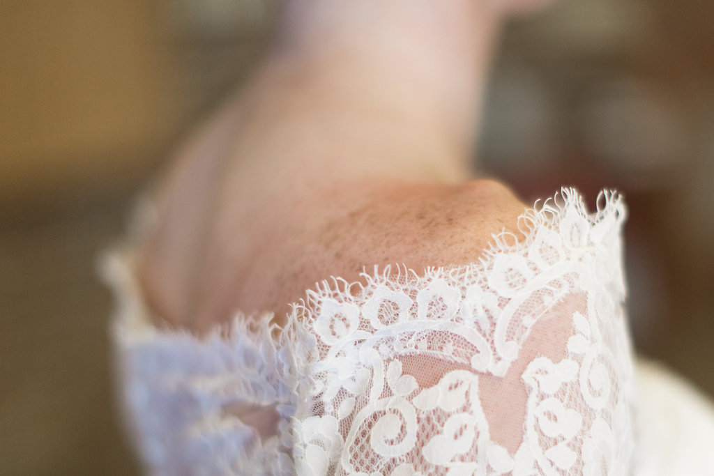 lace off the shoulder cover for wedding dress | shoulder freckles | Ashley Elwill Minneapolis Wedding Photographer
