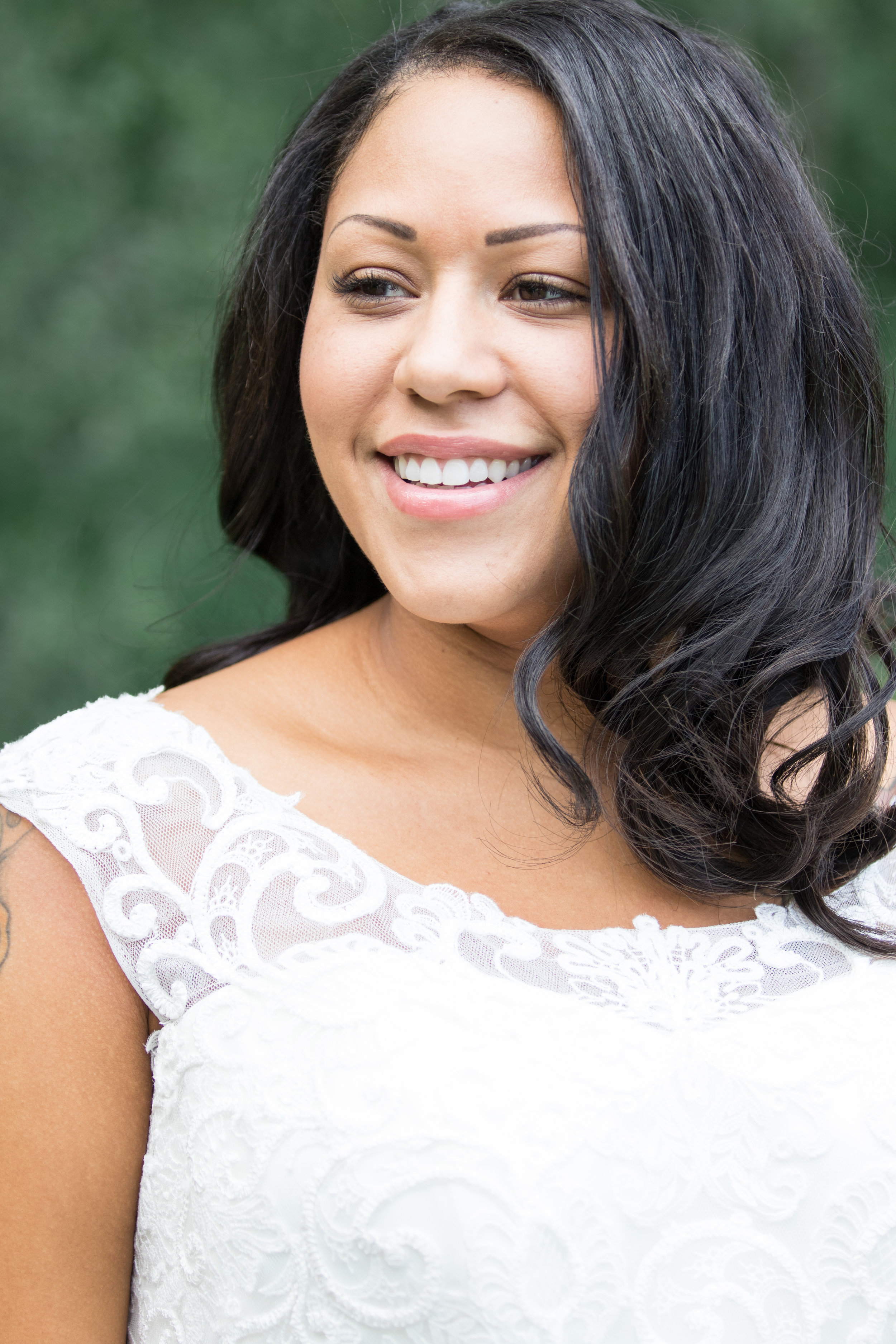 Bride in tasteful wedding dress with a perfect weave, minimal makeup | Photo by Tigerlily Photography