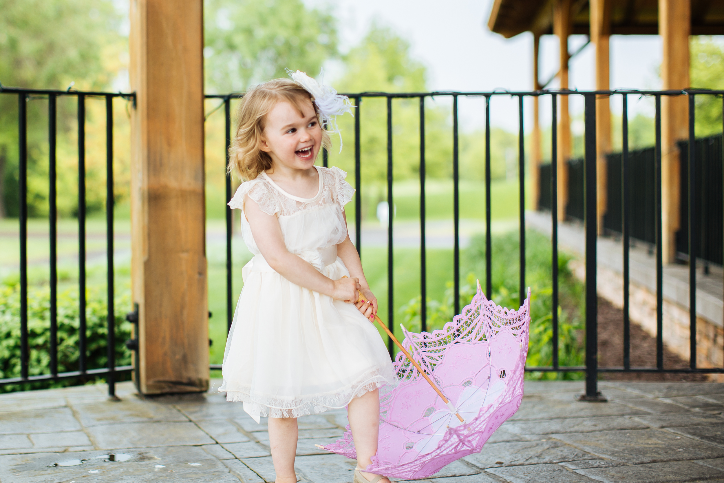 Alyssa Lee Photography | flower girl with a parasole | Sixpence Standard Minneapolis wedding blog