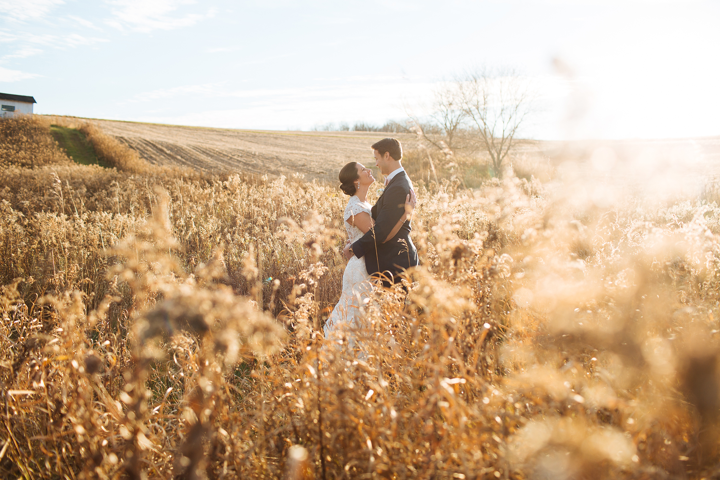 Alyssa Lee Minneapolis Wedding Photographer | Sixpence Standard wedding blog | bride and groom kissing in a field