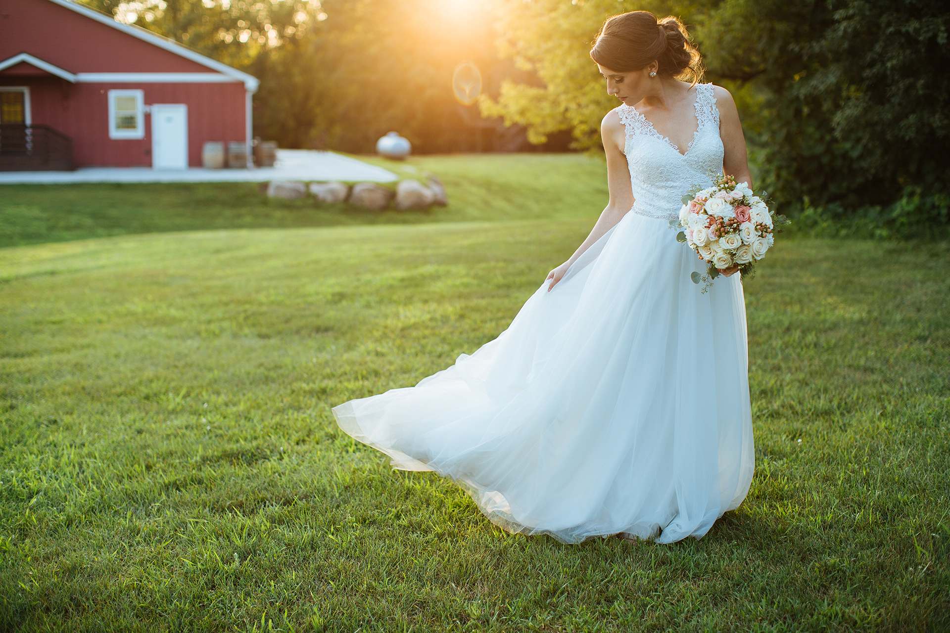 Alyssa Lee Minneapolis Wedding Photographer | Sixpence Standard wedding blog | bride dancing with her dress in a field