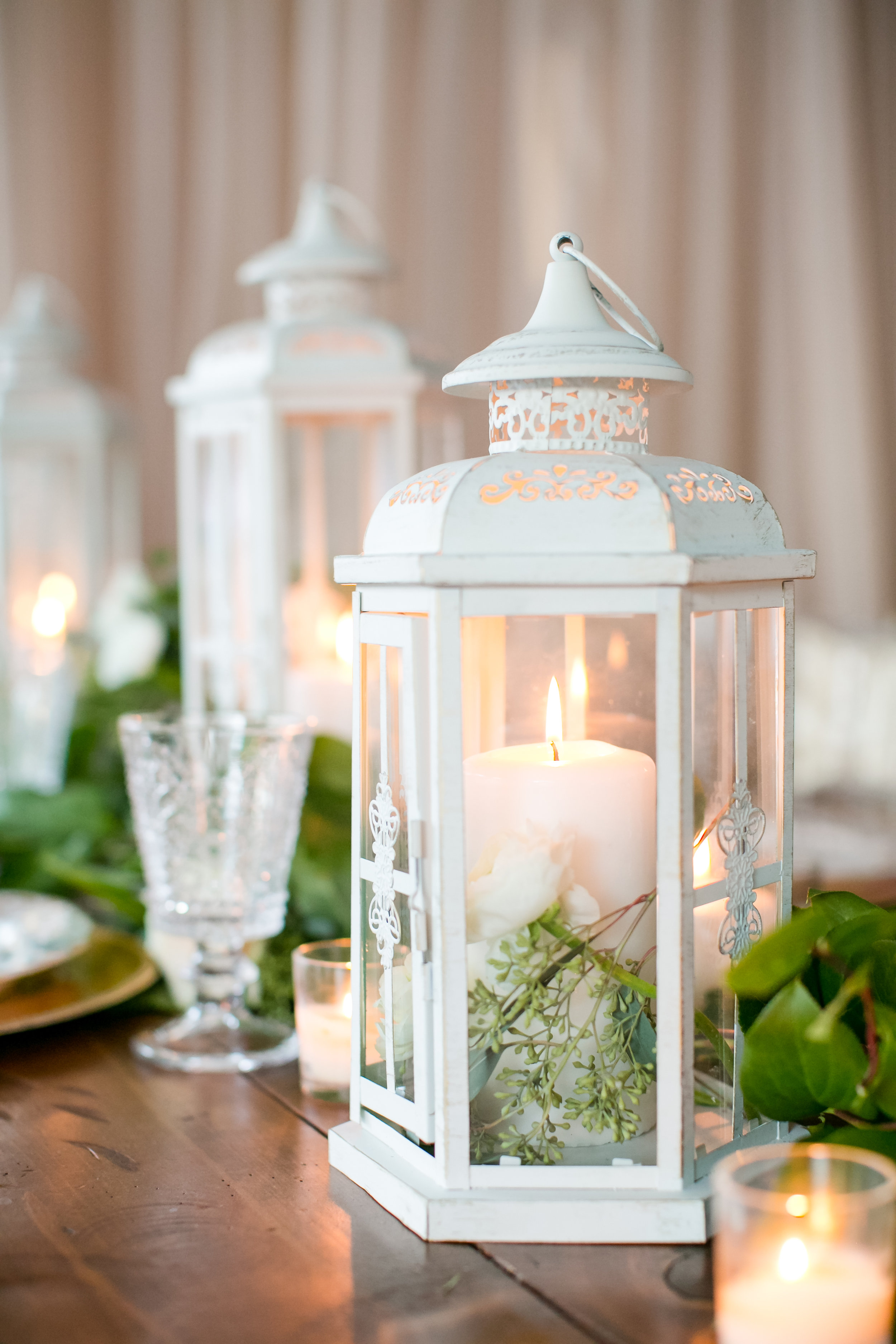 Jeannine Marie Photography | We've Got it Covered | Bel Fiore | Sixpence Events & Planning table styling for wedding blush backdrop, harvest table, clear chiavari chairs with white chair drape, white lanterns and greenery runner