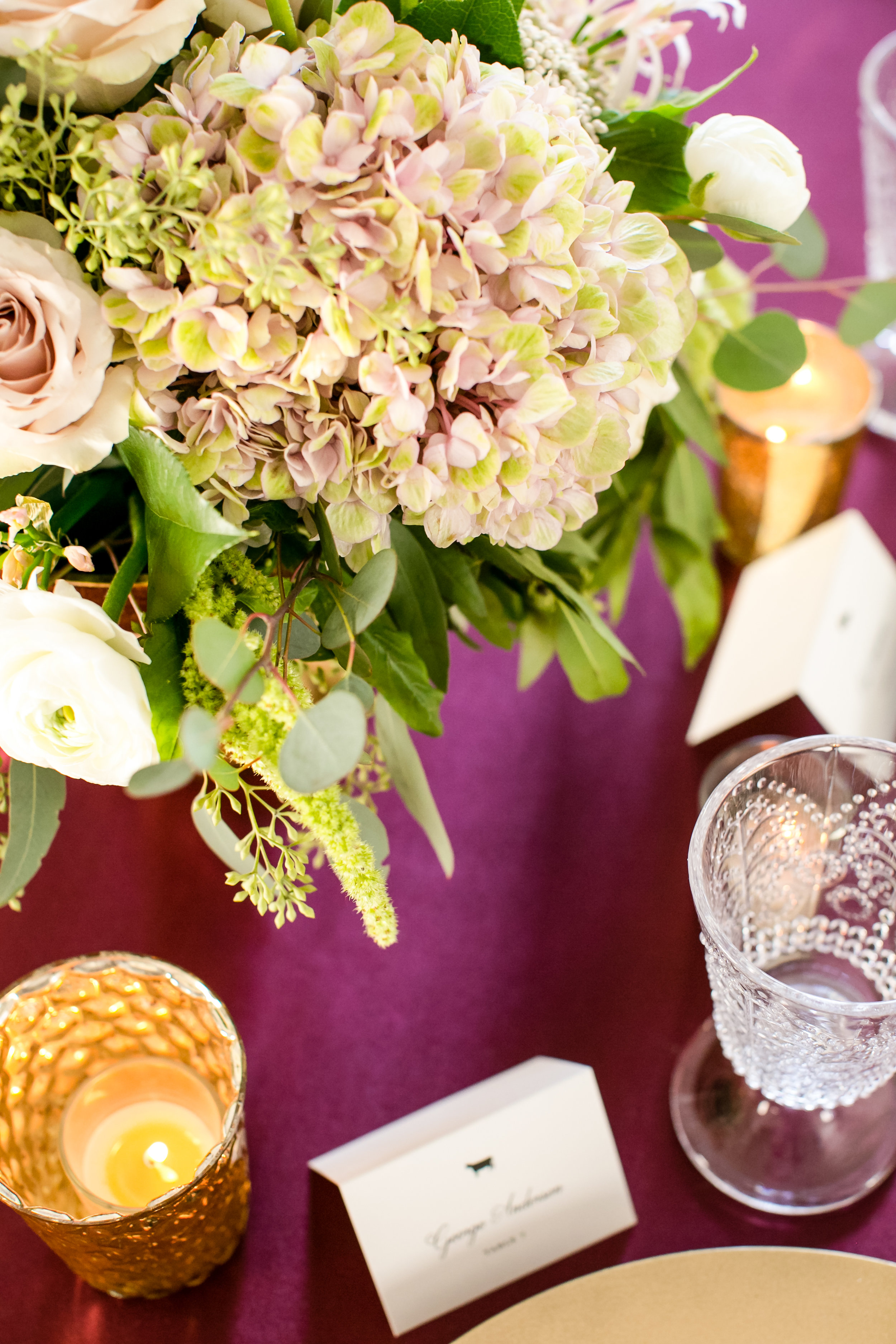Jeannine Marie Photography | We've Got it Covered | Bel Fiore | Sixpence Events & Planning table styling for wedding crimson satin table cloth with gold chargers and white napkins, antique hydrangea