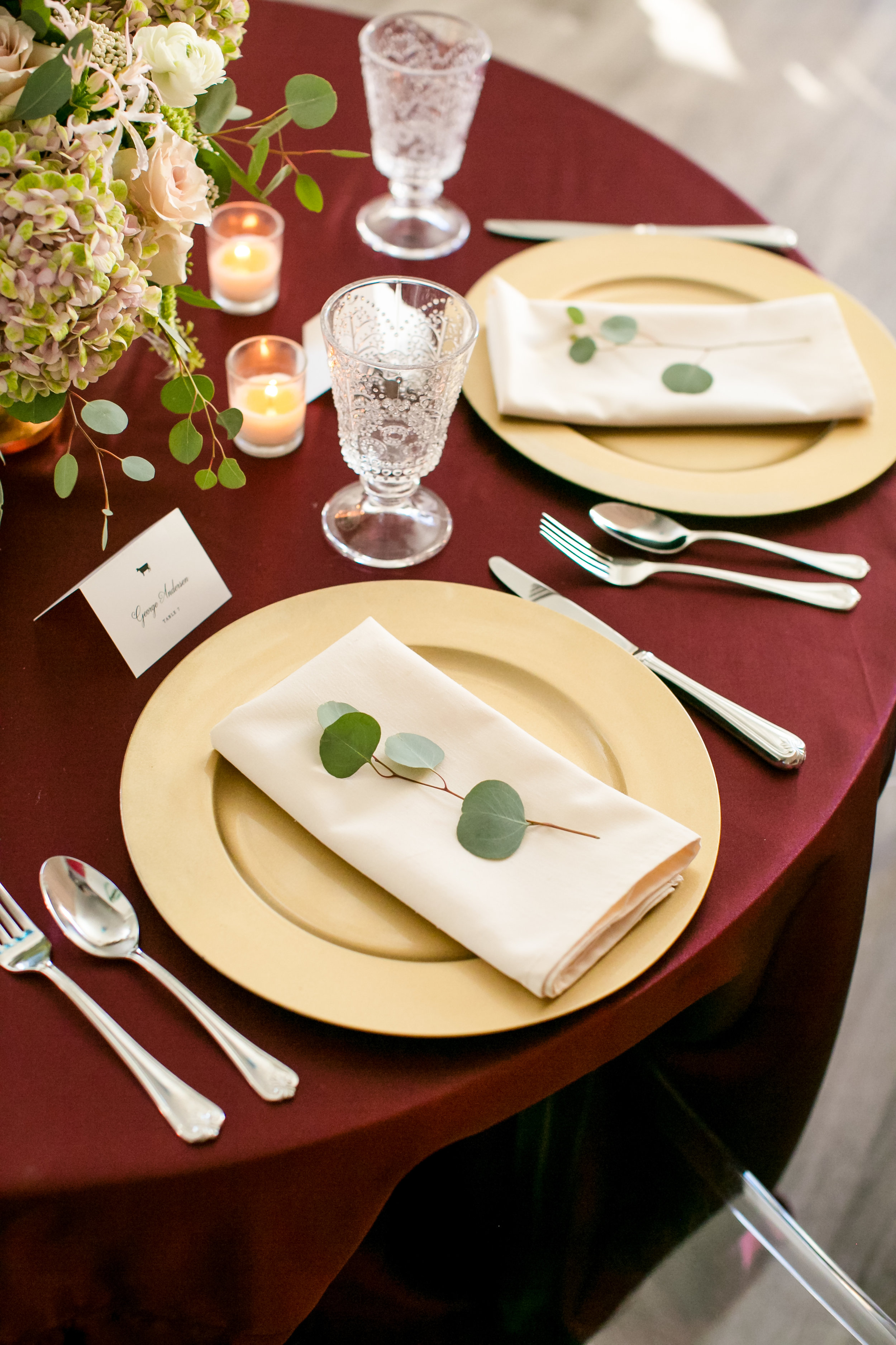 Jeannine Marie Photography | We've Got it Covered | Bel Fiore | Sixpence Events & Planning table styling for wedding crimson satin table cloth with gold chargers and white napkins