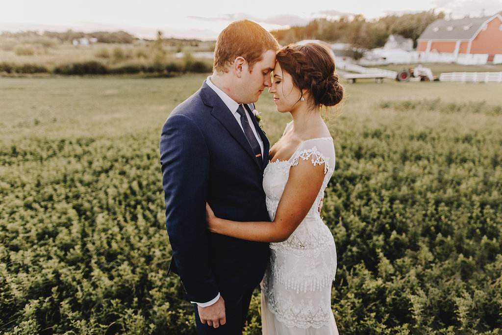 bride and groom, forehead touch in a field  | Acowsay Videography | Matt Lien Photography | Sixpence Standard Wedding Blog | Posh Bridal Couture dress by Claire Pettibone