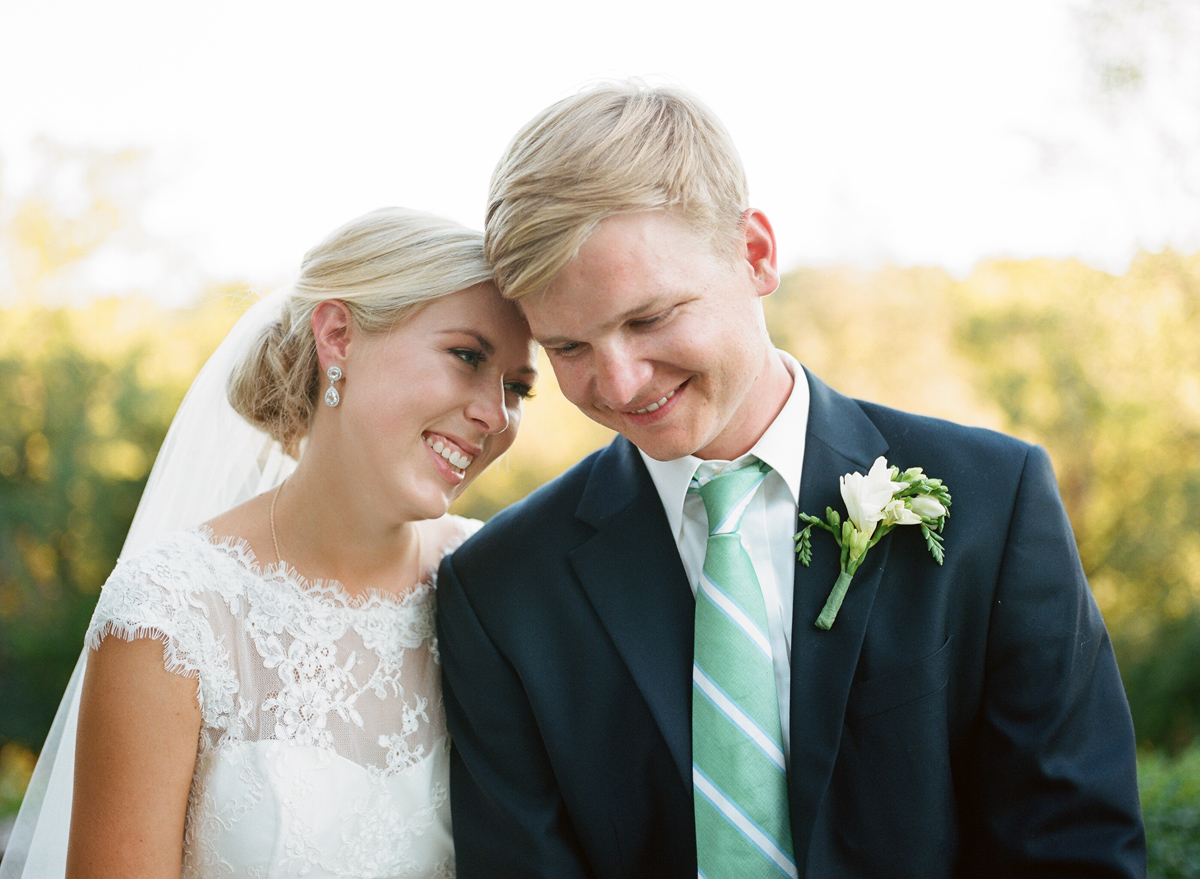 Sarah Jane Photography | mint green striped tie | simple boutonniere | lace short sleeve wedding dress with pearl drop earrings