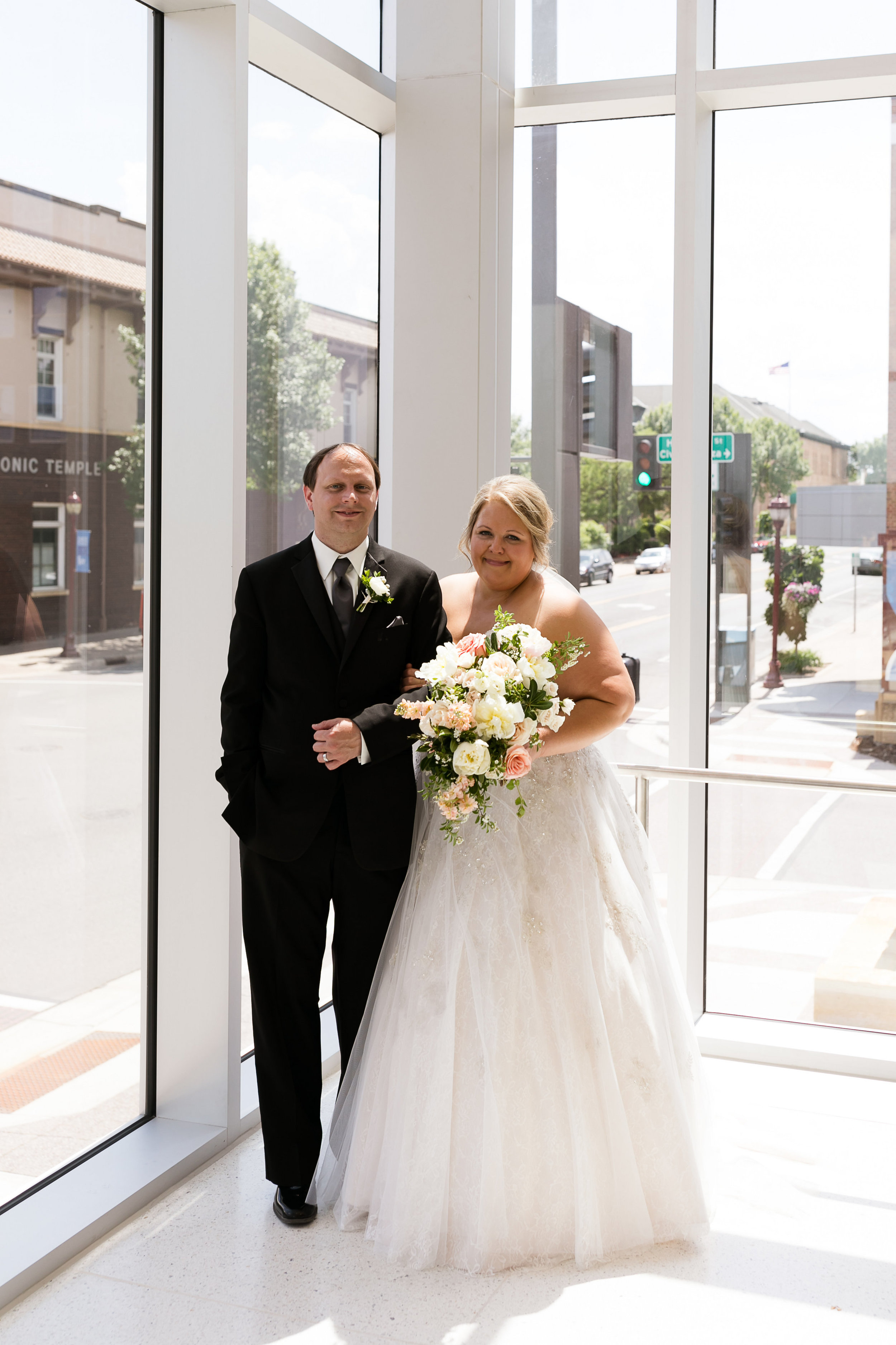 Bride and groom first look | Verizon Wireless Center in Mankato | Luxe Bridal gown | princess ballgown | Alice HQ photography