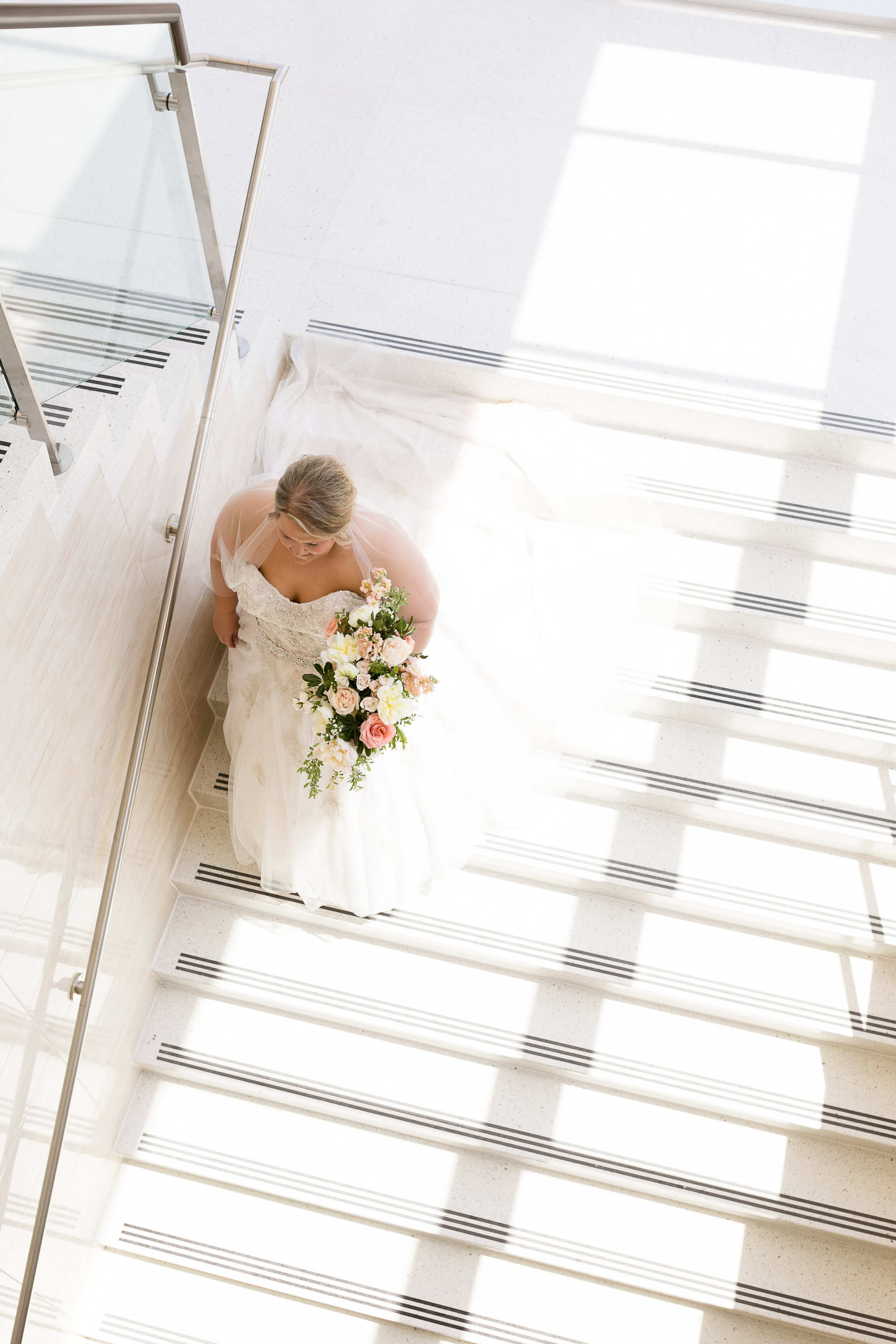 Alice Hq Photographer | Stunning bridal portrait walking down the stairs | full bouquet | princess wedding dress