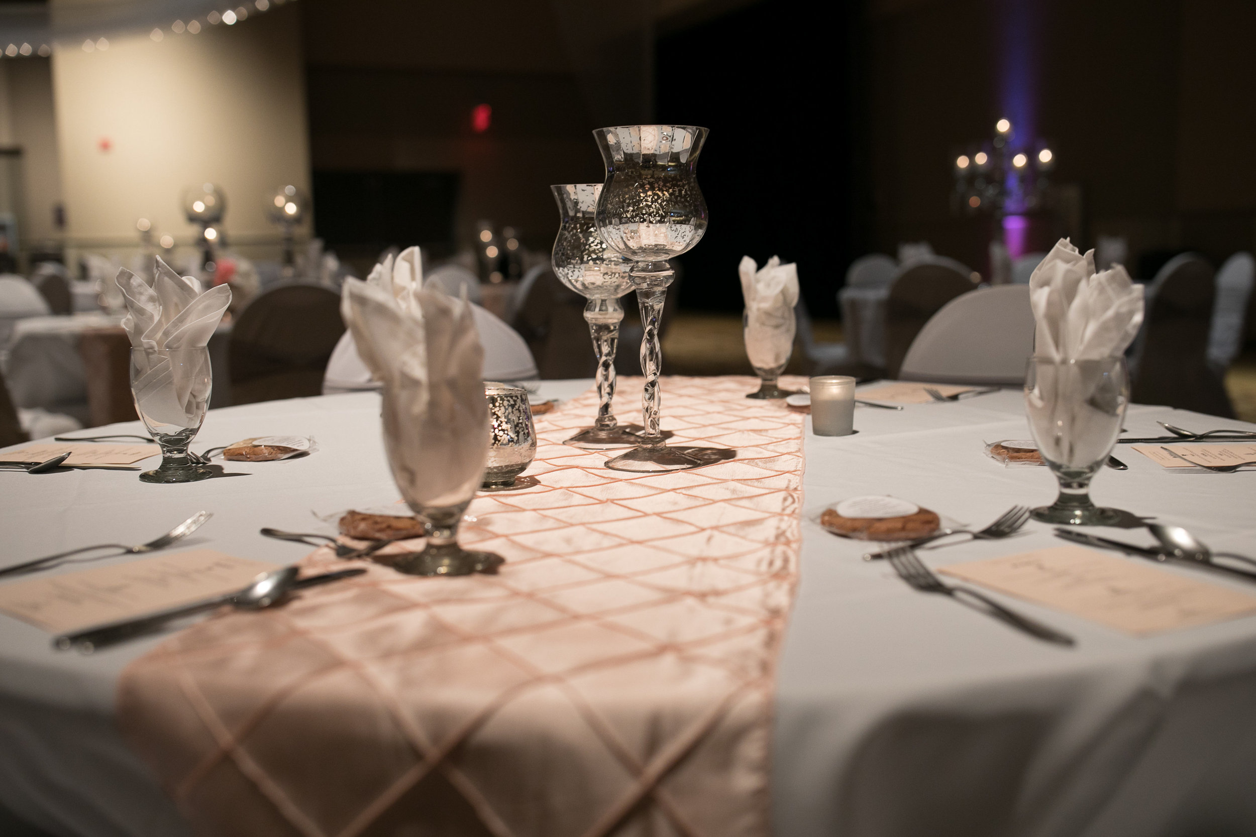 Gray table linen with light pink table runner | cookie guest favor | metallic silver candle holders | simple table decor | Ginger P design menu card | Verizon Wireless Center in Mankato | Alice HQ photography | Everly Lace decor