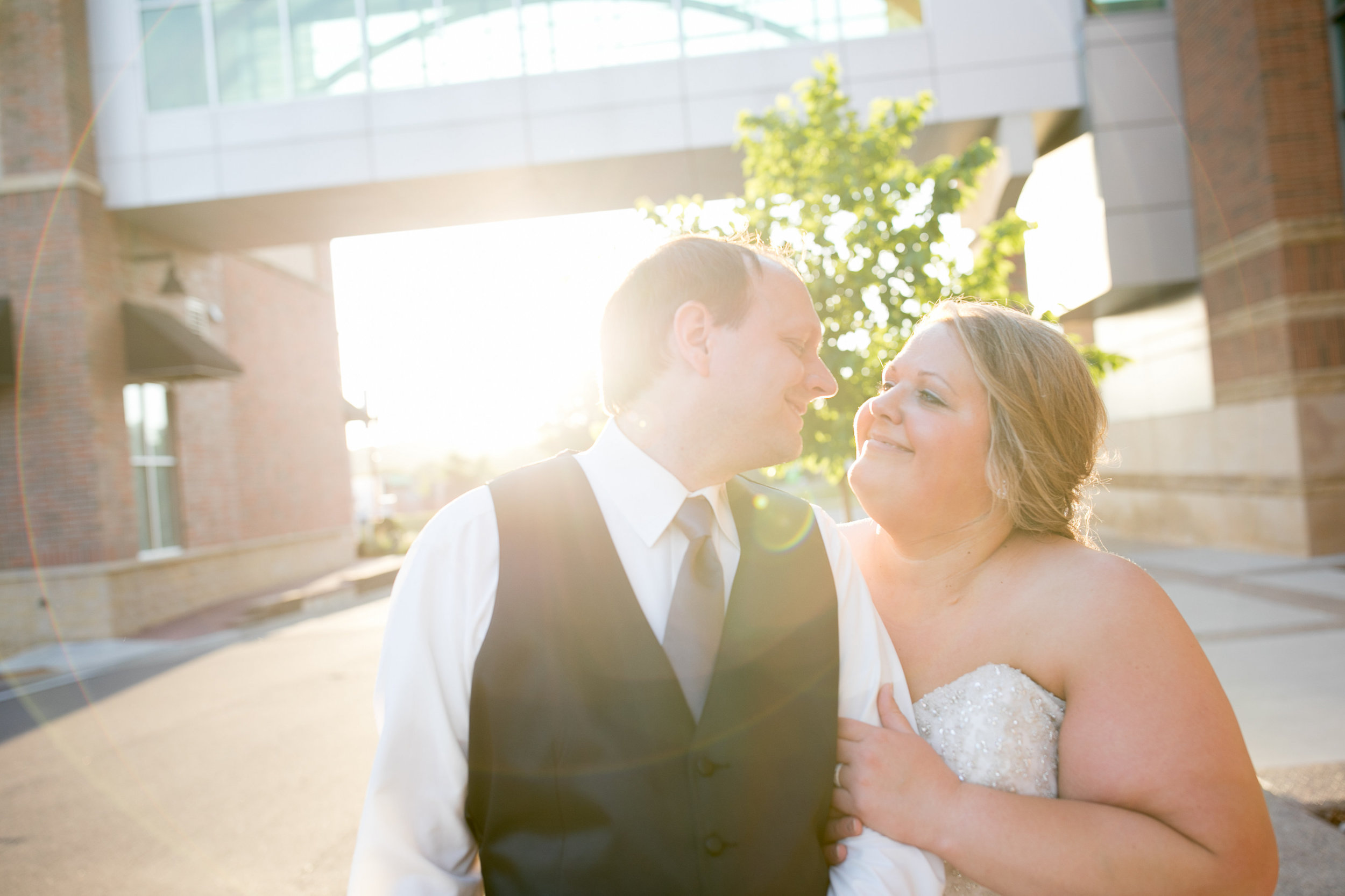 Golden hour sunset photo | Alice HQ Mankato photographer | Luxe bridal gown | dark grey tie | wedding coordinator Sixpence Events