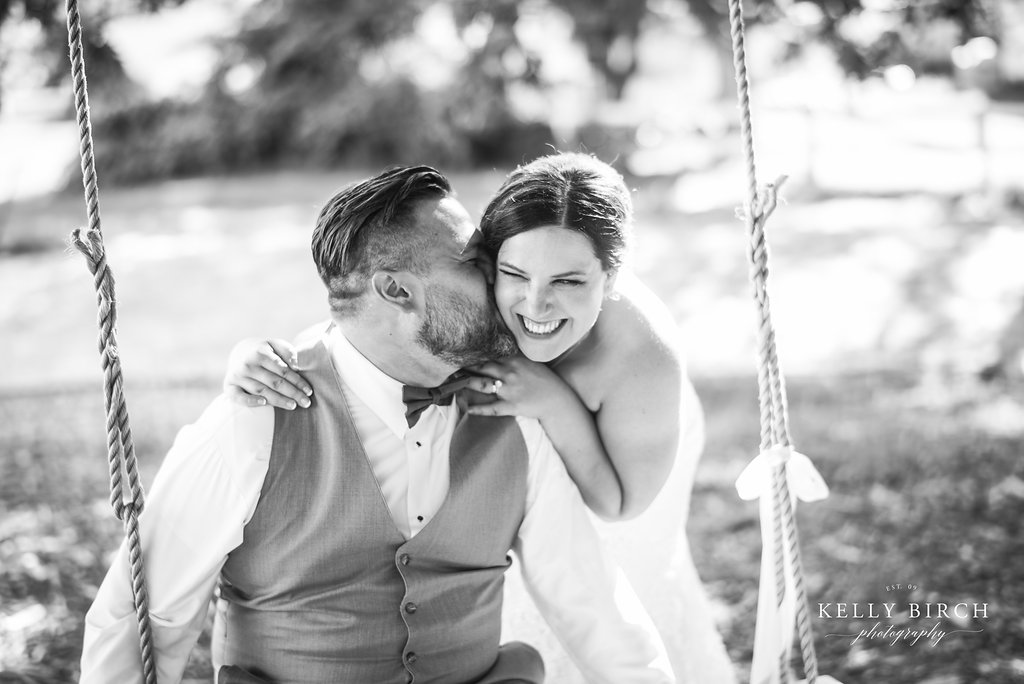Amy and Patrick swing wedding photo | Kelly Birch Photography | Sixpence Events and Planning Day of Coordinating at Hope Glen Farm