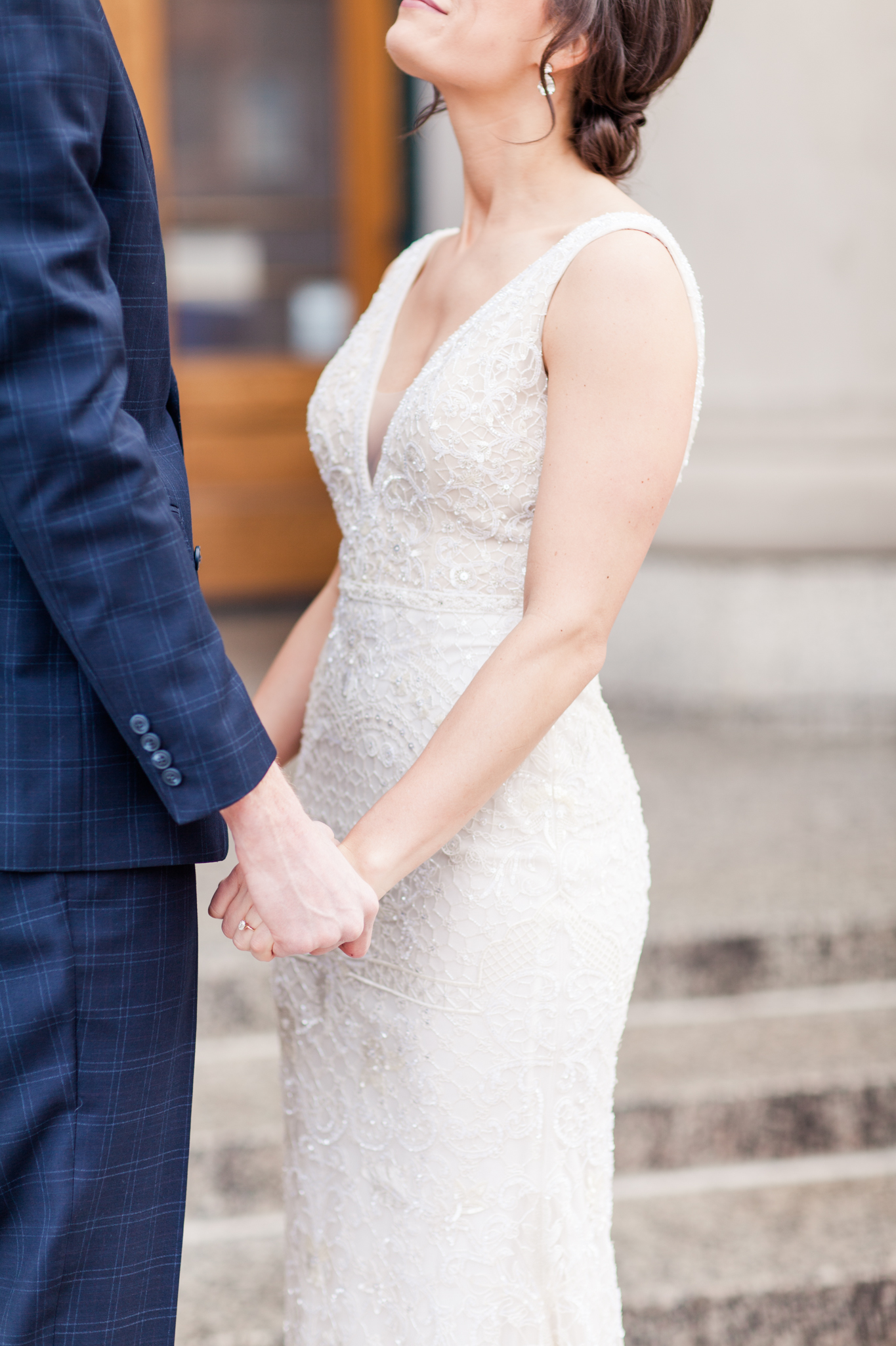 groom in a plaid suit | bride in a v neck and v back wedding dress | Sixpence Events & Planning | Jessa Anderson Photography | winter wedding