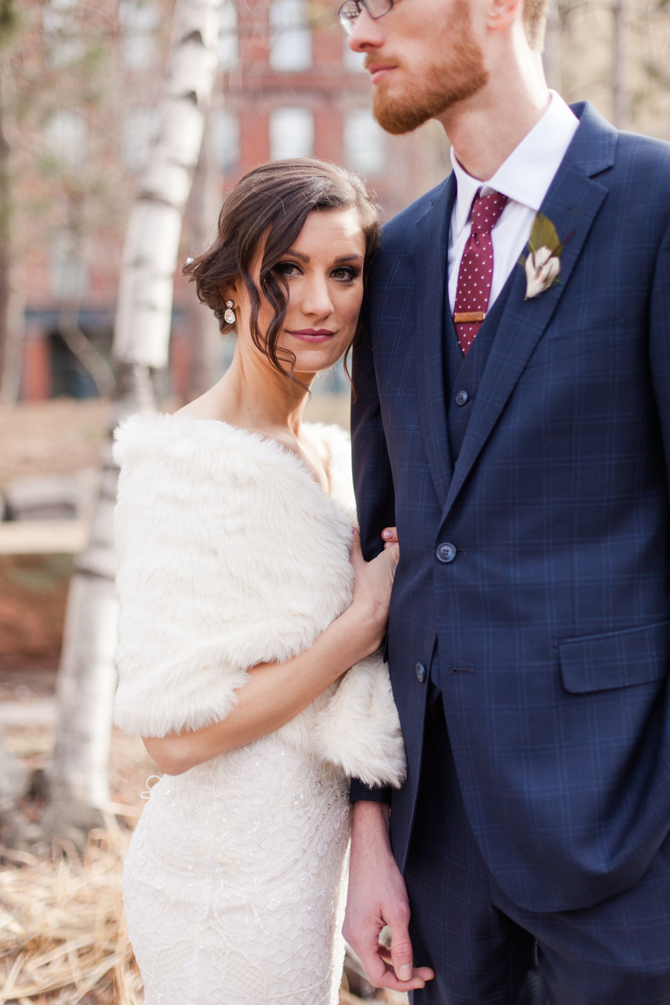 Winter fur wap | plaid suit with crimson tie and fishing lure boutonniere | Sixpence Events & Planning | Jessa Anderson Photography | winter wedding