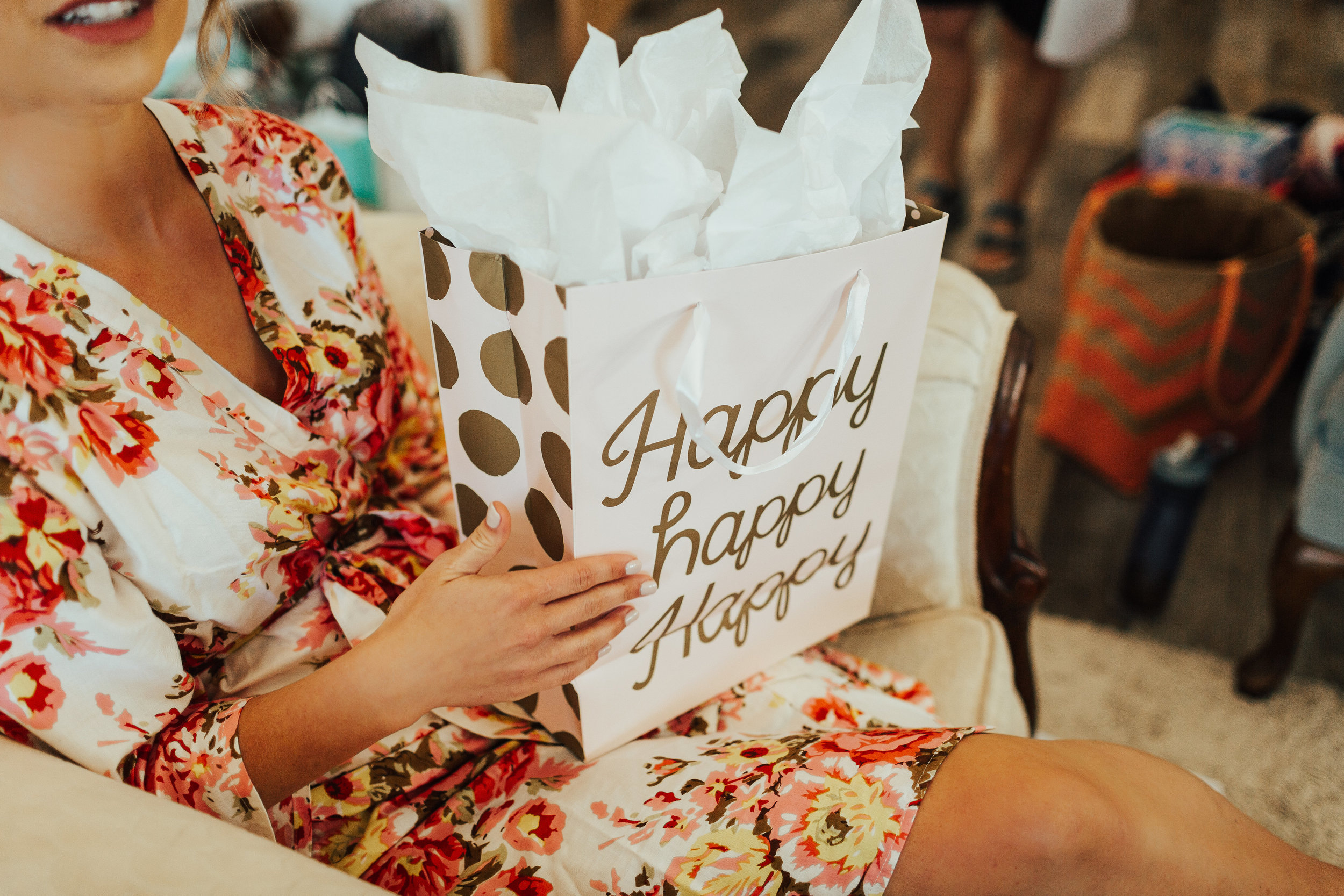 Janelle Elise | Megan + Corey | Furber Farm | Sixpence Events | A Vintage Touch Weddings | happy happy happy wedding bag |  bride opens gifts in bridal suite at Furber farms