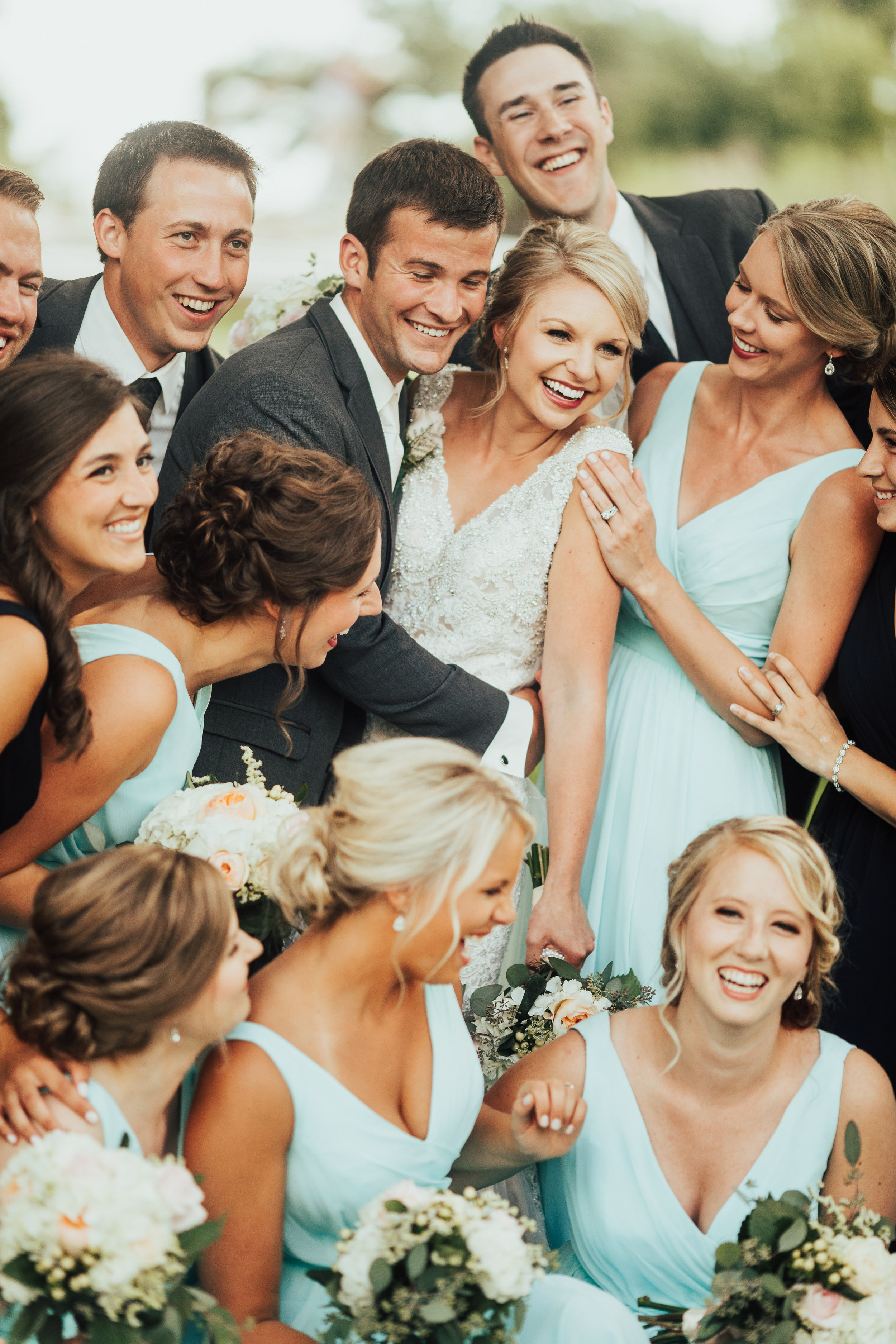 bridal party smush photo | brides in mint green and groomsmen in gray | Janelle Elise | Megan + Corey | Furber Farm | Sixpence Events | A Vintage Touch Weddings84.jpg