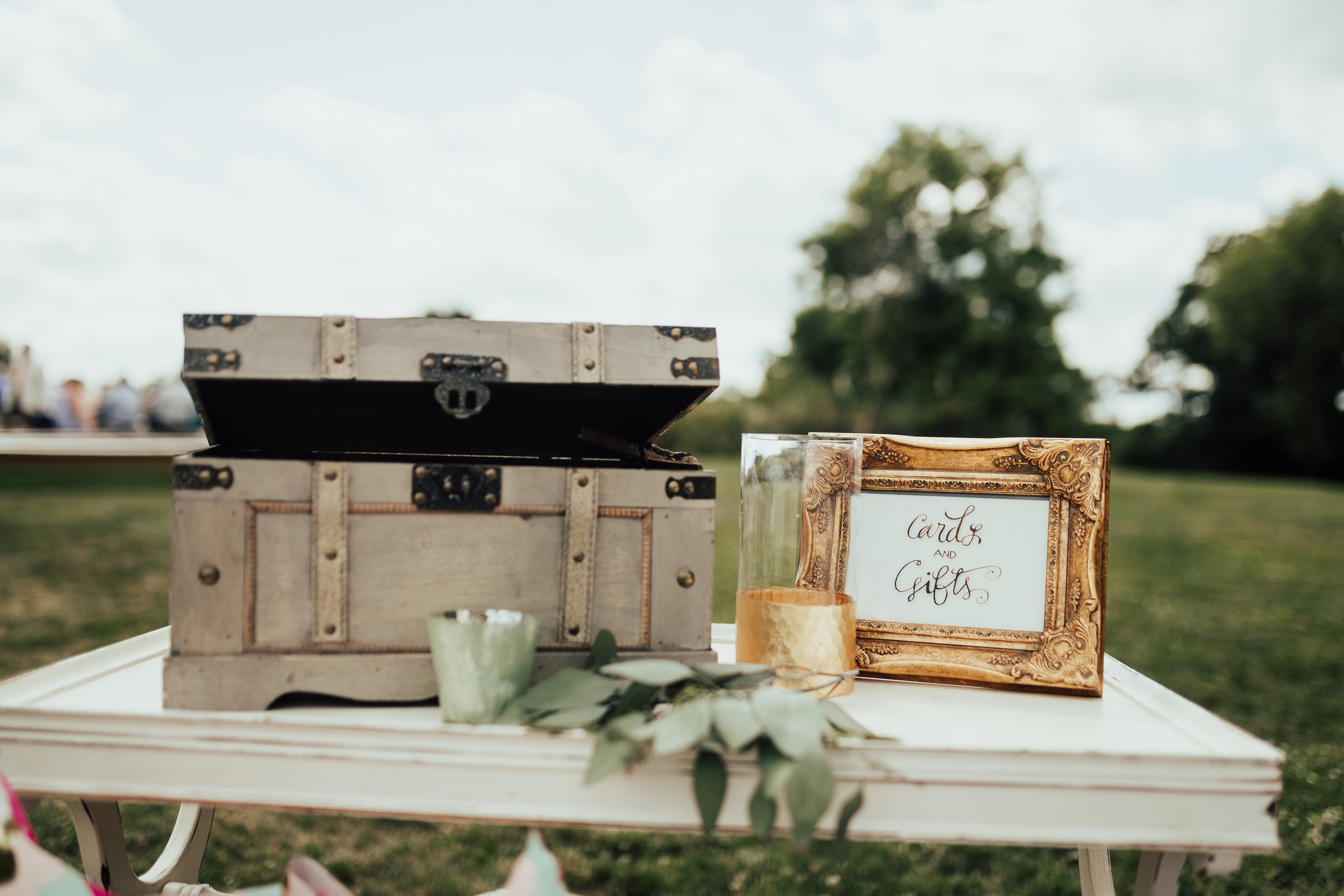 card trunk with calligraphy sign and gold vase | Janelle Elise | Megan + Corey | Furber Farm | Sixpence Events | A Vintage Touch Weddings94.jpg