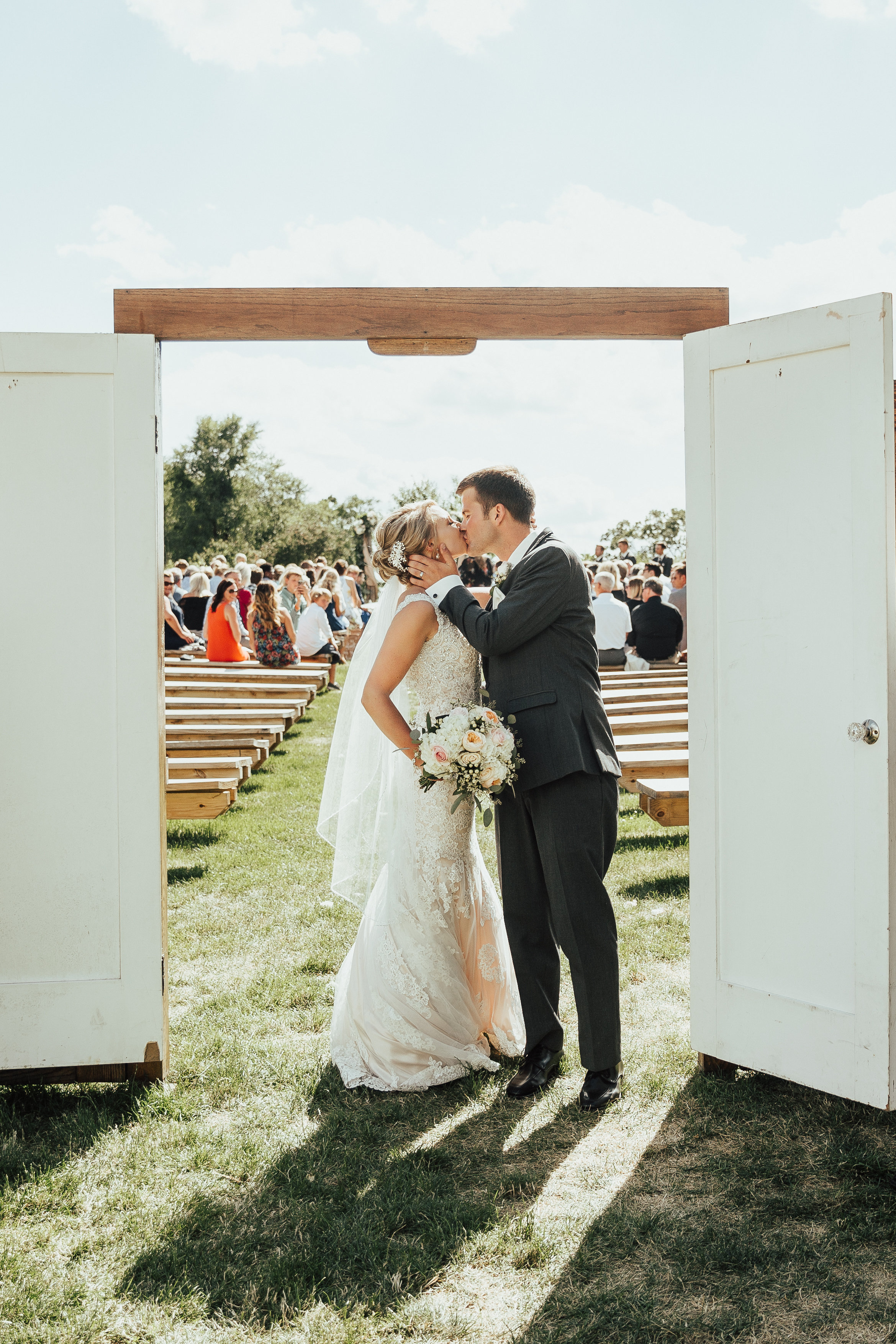 just married exit kiss in the white doors | Janelle Elise | Megan + Corey | Furber Farm | Sixpence Events | A Vintage Touch Weddings106.jpg