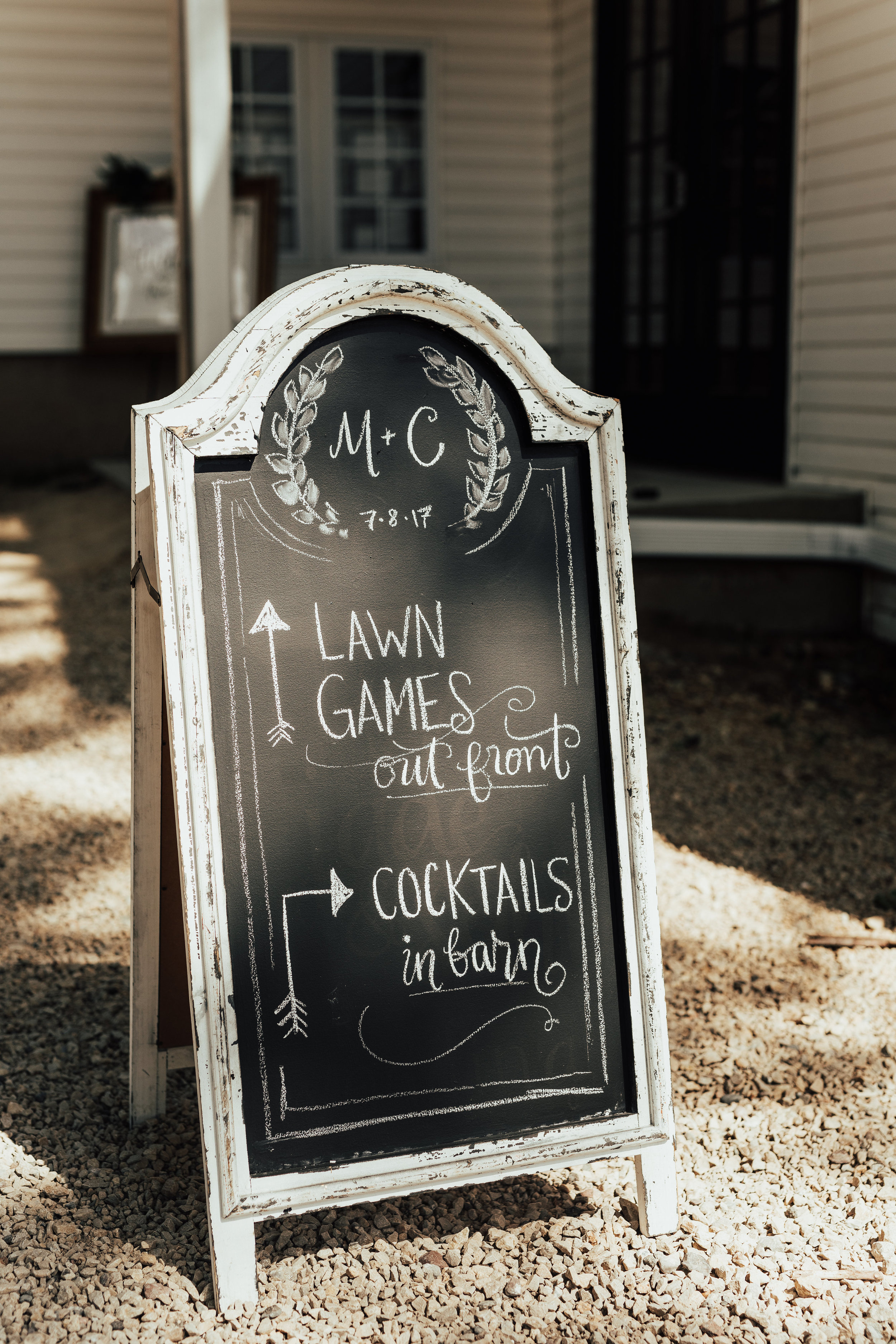 direction sandwich board sign with custom crest | lawn games sign and cocktail bar sign | Janelle Elise | Megan + Corey | Furber Farm | Sixpence Events | A Vintage Touch Weddings