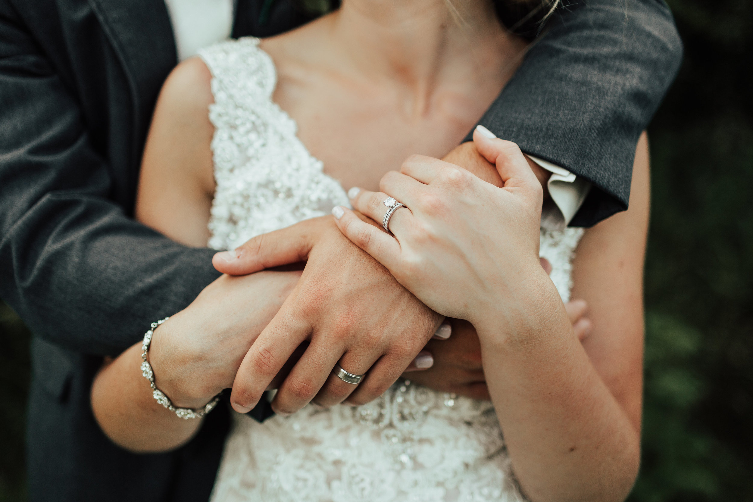 Josey Meeker stafford | Janelle Elise Photography | hug photo with rings and bracelet detail | gray suit for groom | Furber Farm