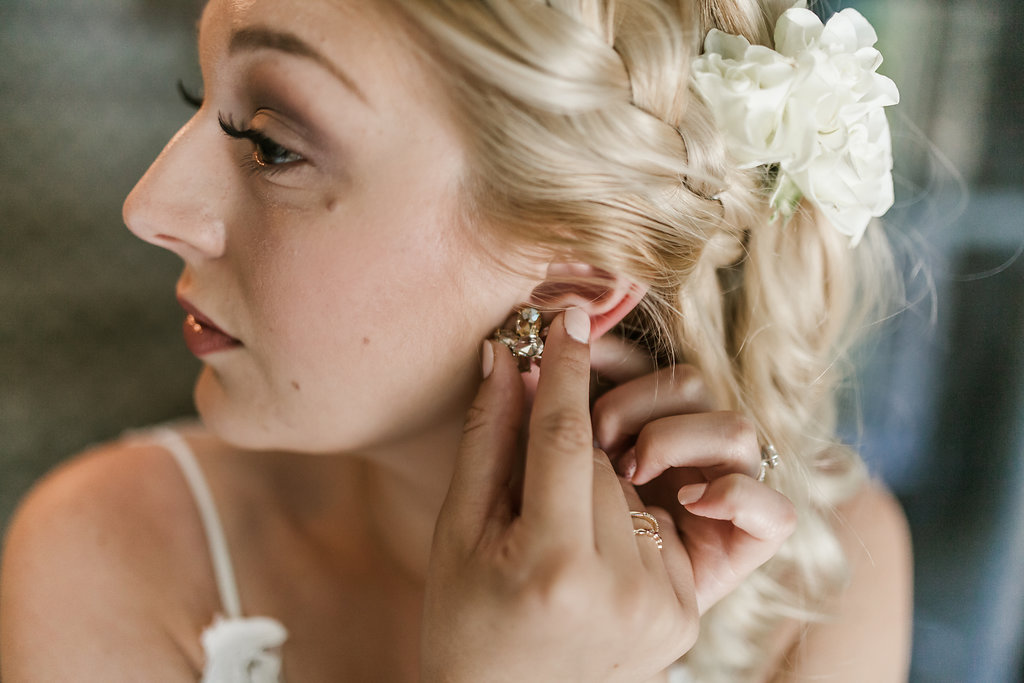 bridal jewelry | braid with white hair flowers | Aaron T Photography | Nicolett Island | Sixpence Events and Planning day of coordinating and wedding blog