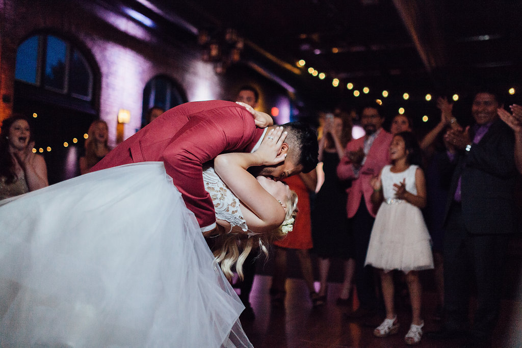 dip kiss on the dance floor  | Aaron T Photography | Nicollet Island Pavilion | Sixpence Events & Planning wedding blog