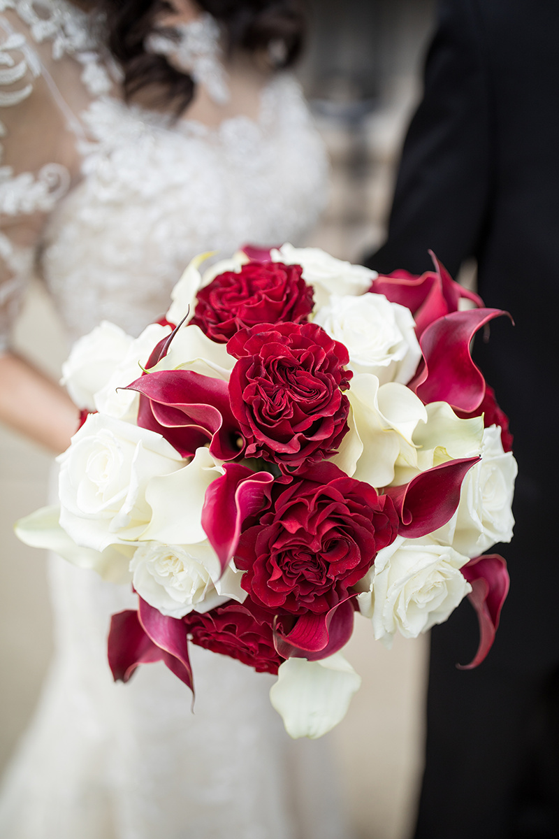 bridal bouquet with red cabbage roses and red calla lilies with white roses and calla lilies | bridal gown with lace bodice  | Brian Bossany Photography | Sixpence Events & Planning wedding blog and day of coordinating