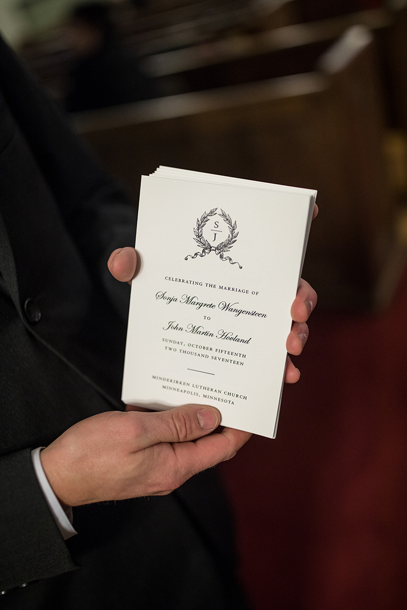 Mindekirken wedding ceremony | Papyrus ceremony program with crest and calligraphy  | Brian Bossany Photography | Sixpence Events & Planning wedding blog and day of coordinating