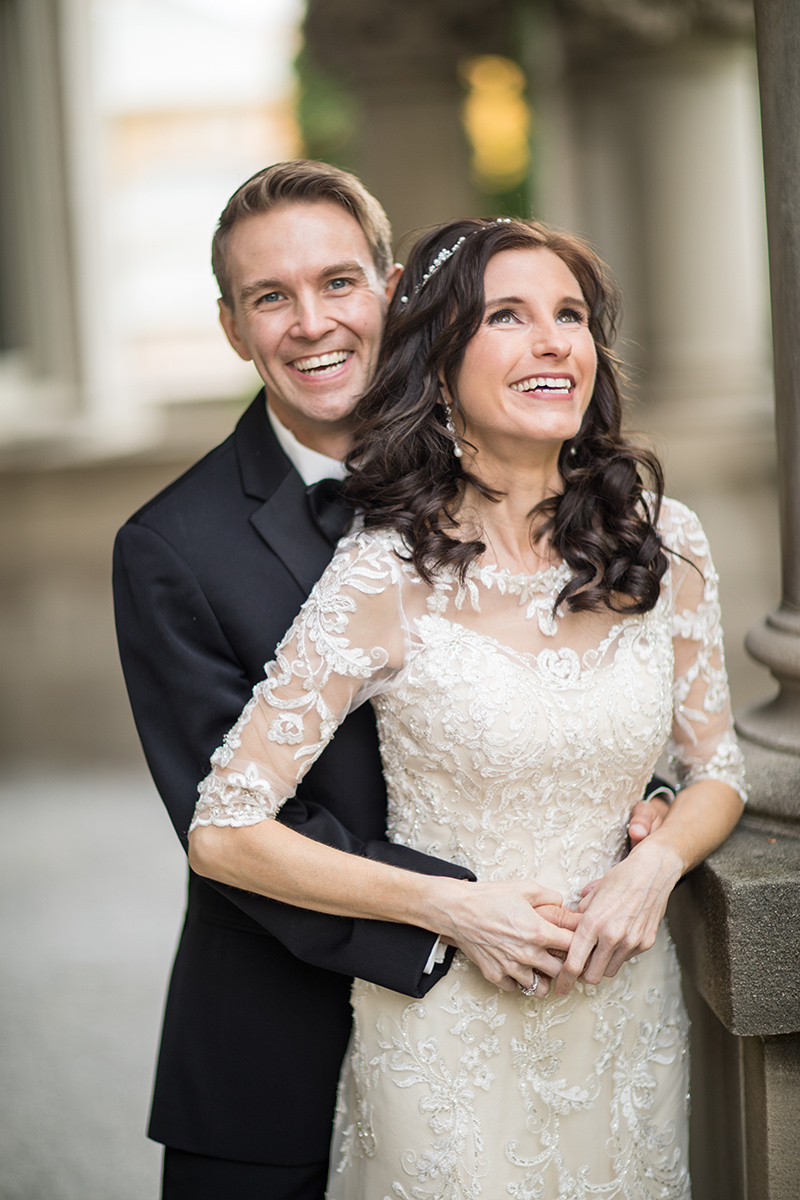 Sonja and John happy married couple | bride with lace sleeves | Brian Bossany Photography | Sixpence Events & Planning