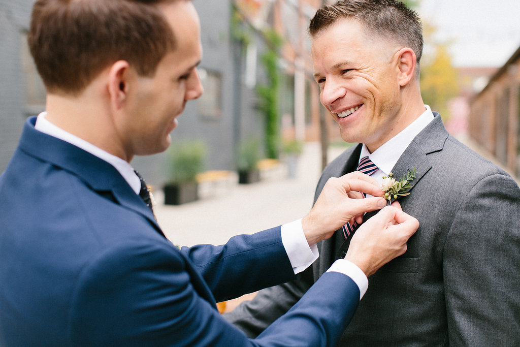 Carly Milbrath Photography | Justin and Jacob | PAIKKA Minnesota Wedding Venue | Same sex wedding with two grooms | pin on your groom's boutonniere