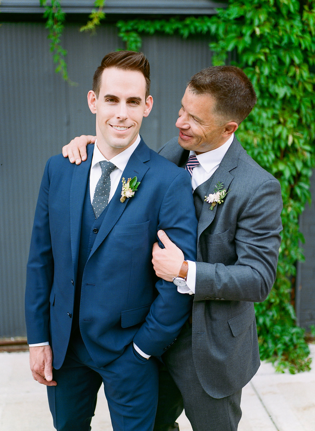Carly Milbrath Photography | Justin and Jacob | PAIKKA Minnesota Wedding Venue | Same sex wedding with two grooms portrait | groom in navy suit | groom in gray suit | polka dot tie | stripe tie