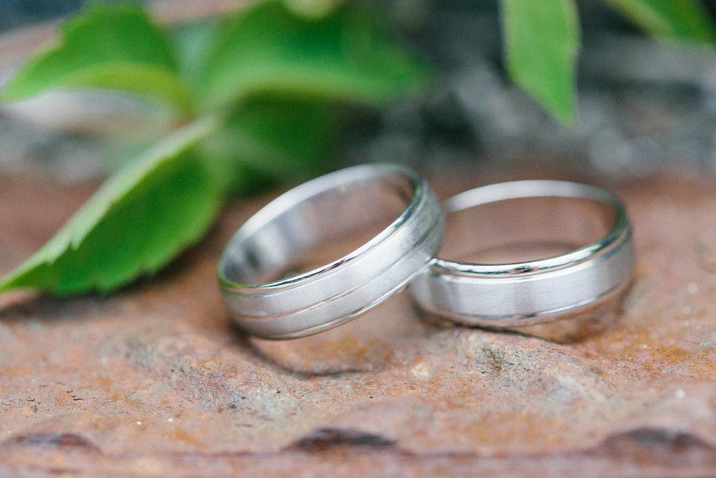Carly Milbrath Photography | Justin and Jacob | PAIKKA Minnesota Wedding Venue | grooms complimentary wedding bands