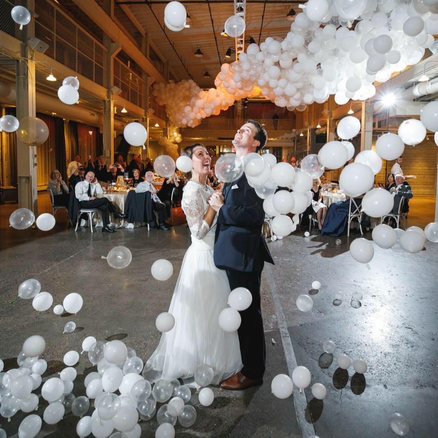 Hannah and Jason mini balloon drop during first dance at Machine Shop