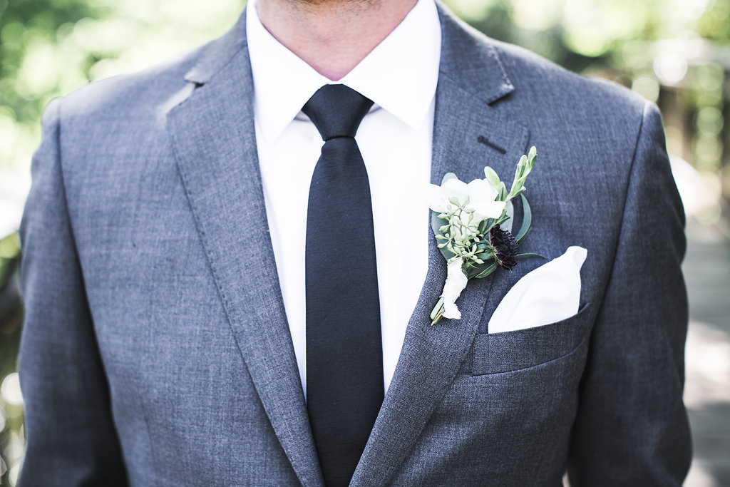 Aaron Rice Photography   Annunciation Ceremony   Day Block Wedding Reception   Sixpence Events and Planning Minnesota Wedding planner   grooms boutonniere with a grey suit and black tie