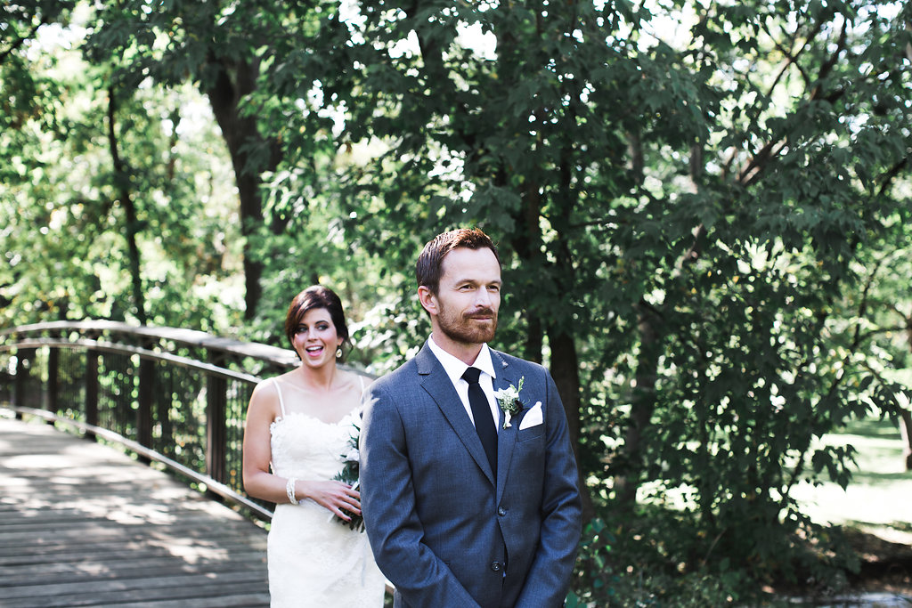 Aaron Rice Photography   Minnehaha Creek Park first look   wedding dress with straps   Sixpence Events day of coordinating   groom in a grey suit with black tie