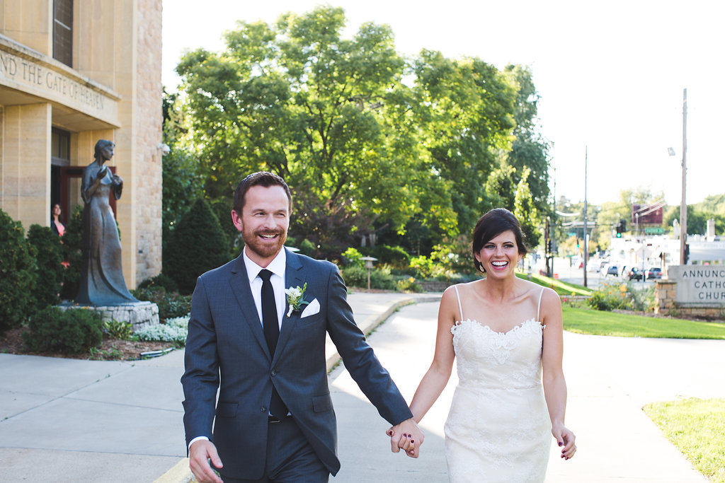 just married walk Annunciation Church in Minneapolis   Aaron Rice Photography   Sixpence Events day of coordinating   DIY wedding decor
