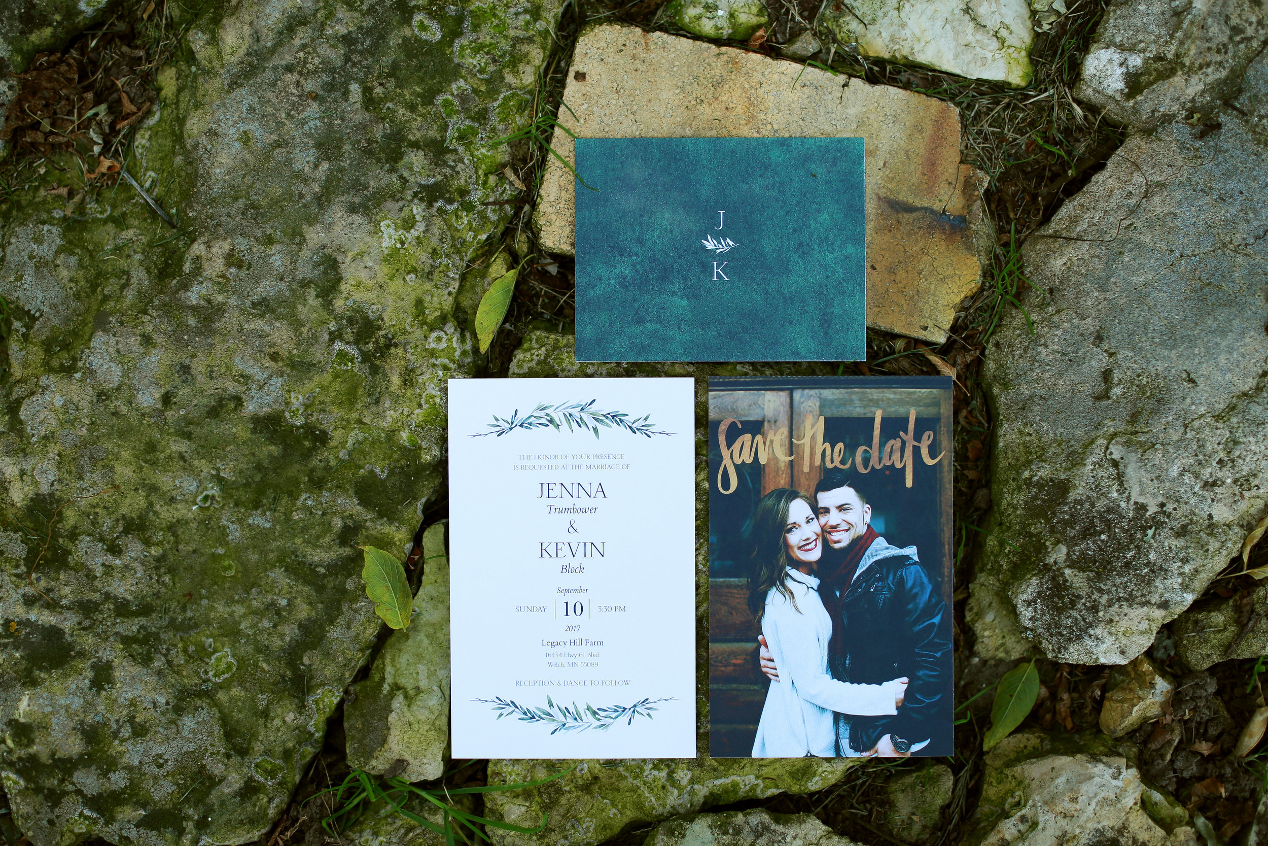 Jenna Kevin Wedding   Hannah Schmitt Photography   wedding invitation and save the date suite detail shot   greenery, flat lay on rocks