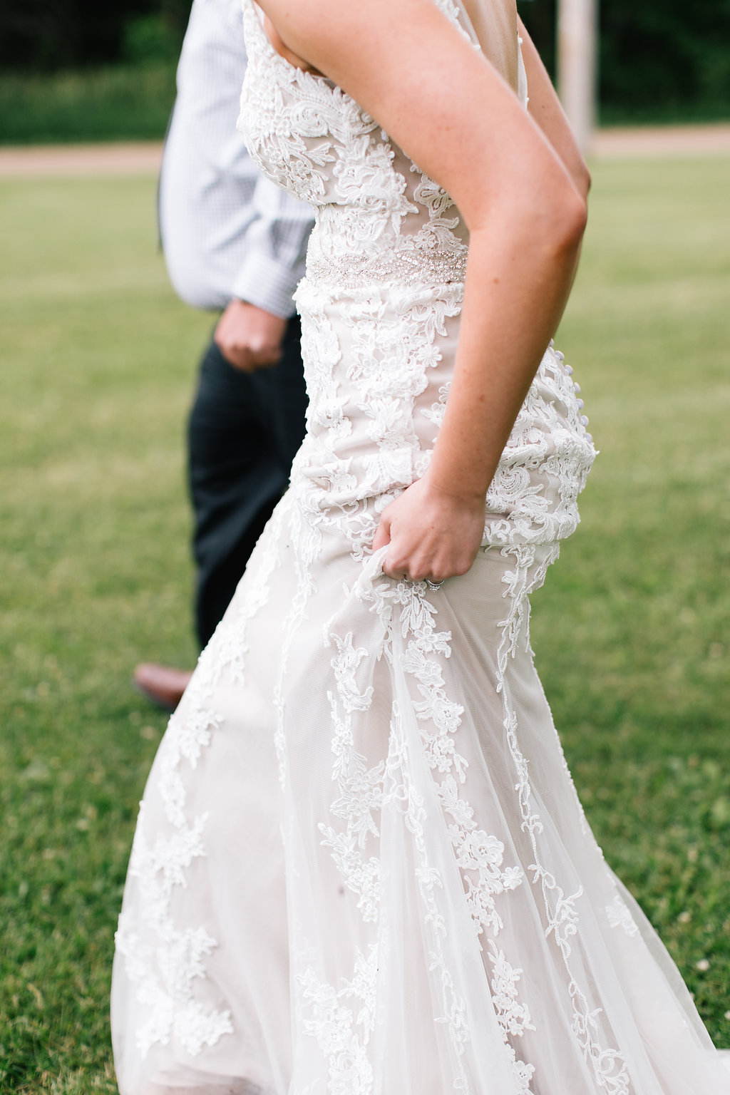 Jade + Seth Wedding | Allison Hopperstad Photography | Bloom Lake Barn | walking to the first look | bride in lace wedding dress with straps
