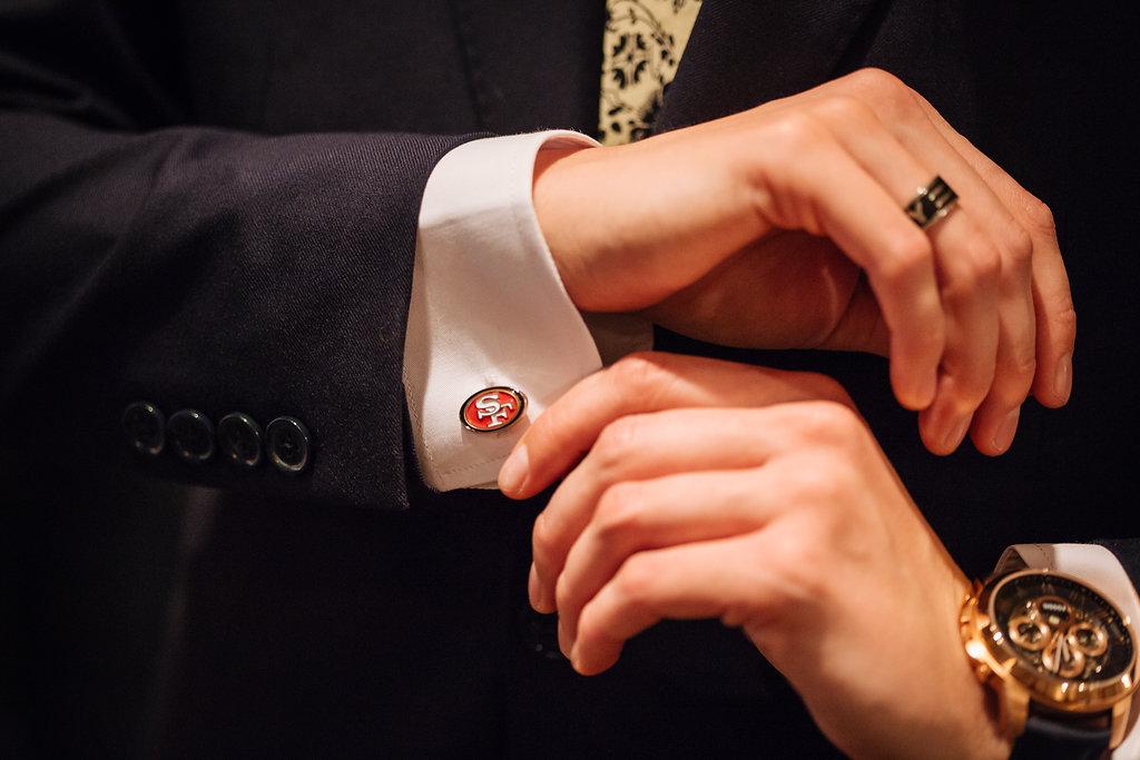 Julia + Johanna | Alyssa Lee Photography | Camrose Hill Flower Studio | detail shot of san francisco cuff links and fancy watch