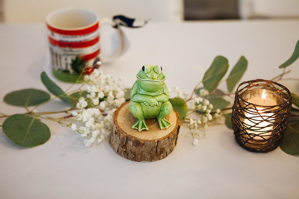 Julia + Johanna | Alyssa Lee Photography | Camrose Hill Flower Studio | Sixpence Events and Planning day of coordinating | frog salt and pepper shaker table number on wood cut with mugs as wedding favors